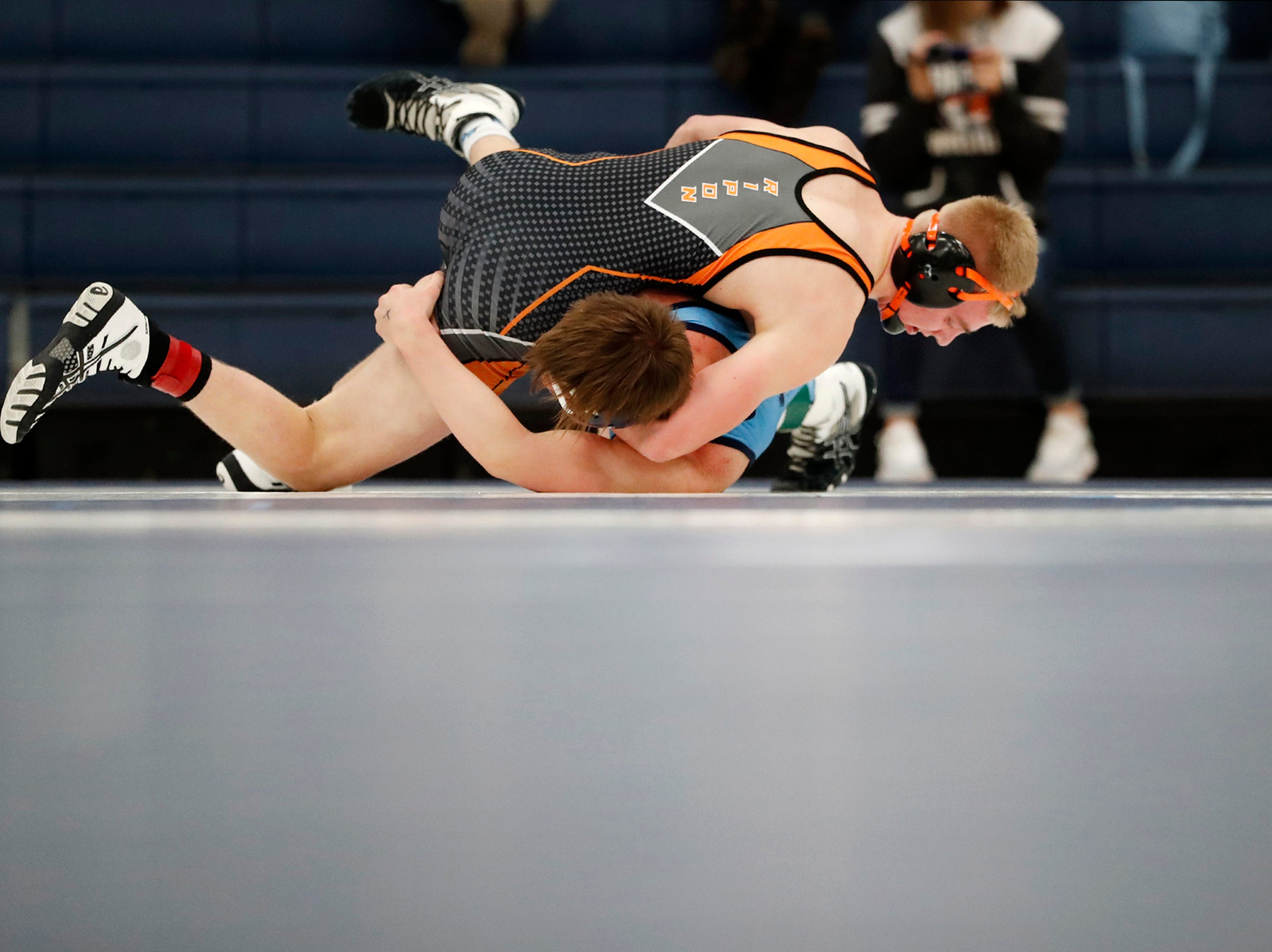 Little Chute's Logan Lex tries to escape Ripon's Brady Kissinger during their 160-pound match at the D2 wrestling regional Saturday Feb. 9, 2019, in Little Chute, Wis.