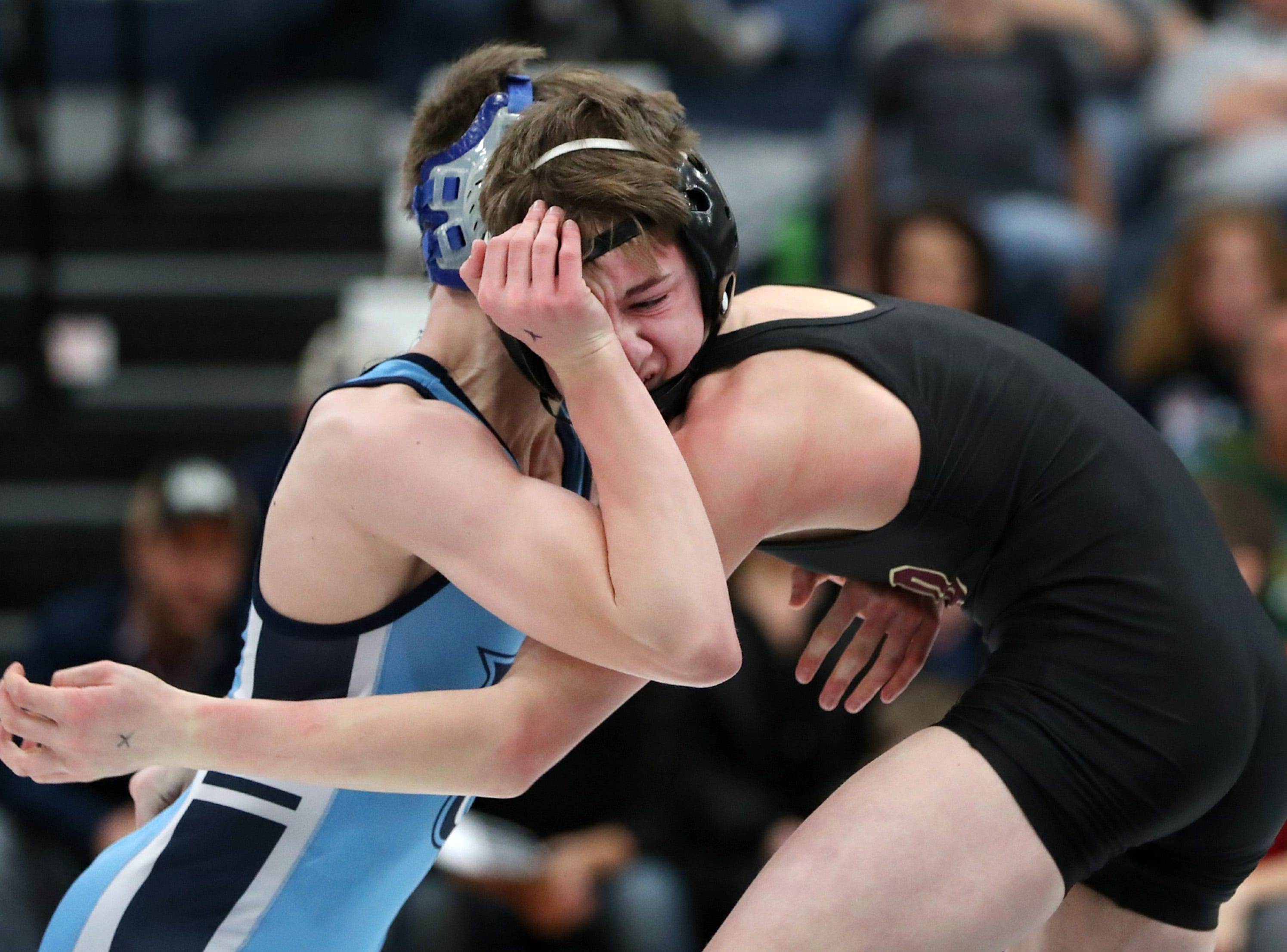 Little Chute's Noah Kilgas wrestles Omro's Kaden Besaw during their 120-pound first place match in the D2 wrestling regional Saturday Feb. 9, 2019, in Little Chute, Wis. Besaw won the match with a fall in 2:08.