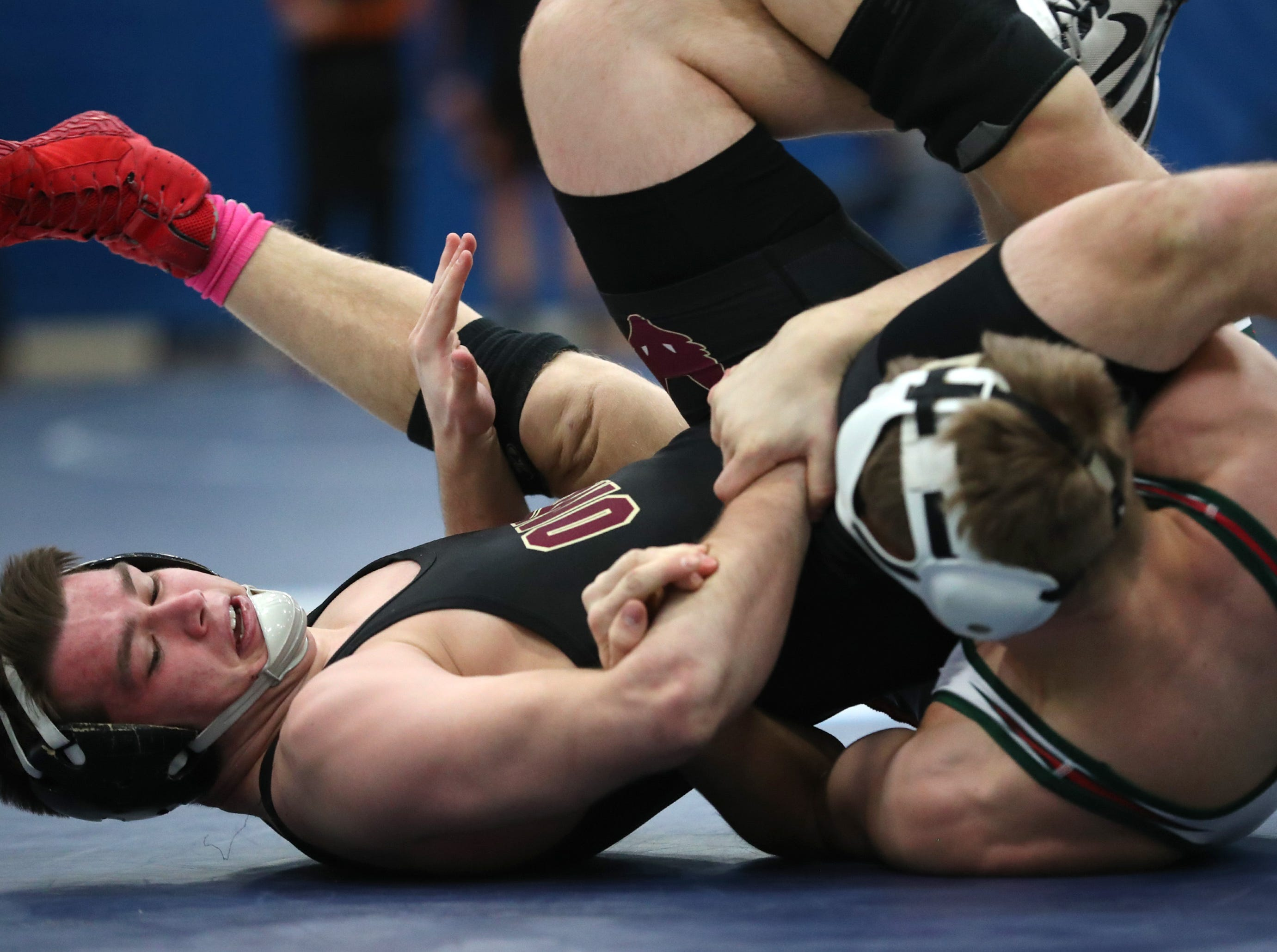 Omro's Jacob Kafer and Berlin's Austin Schrei wrestle for first place in the 170-pound division during the D2 wrestling regional Saturday Feb. 9, 2019, in Little Chute, Wis. Schrei won the match 8-2.