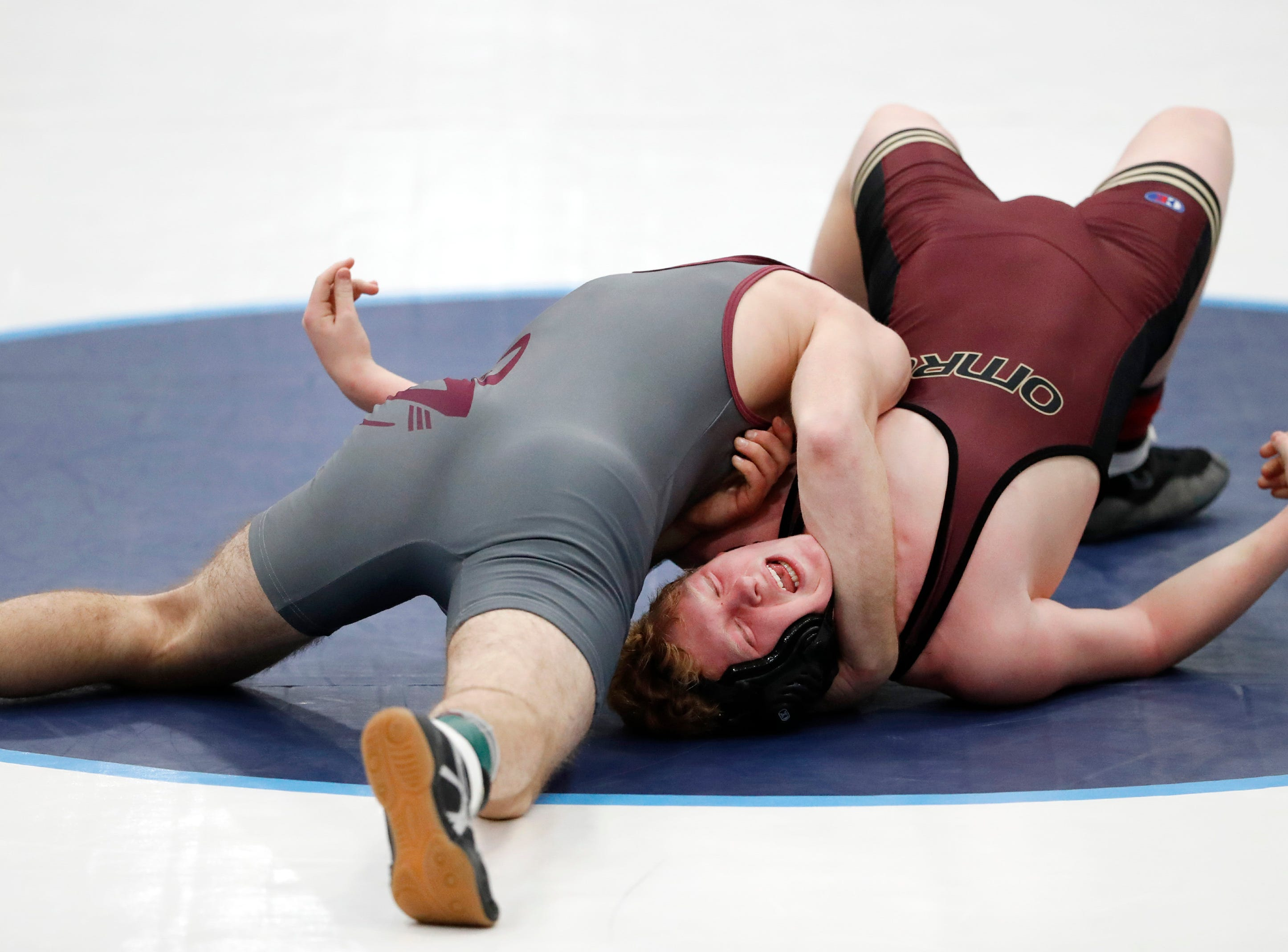 Fox Valley Lutheran's Arthur Rice tries to pin Omro's Ben Stone during their 160-pound match during the D2 wrestling regional Saturday Feb. 9, 2019, in Little Chute, Wis.