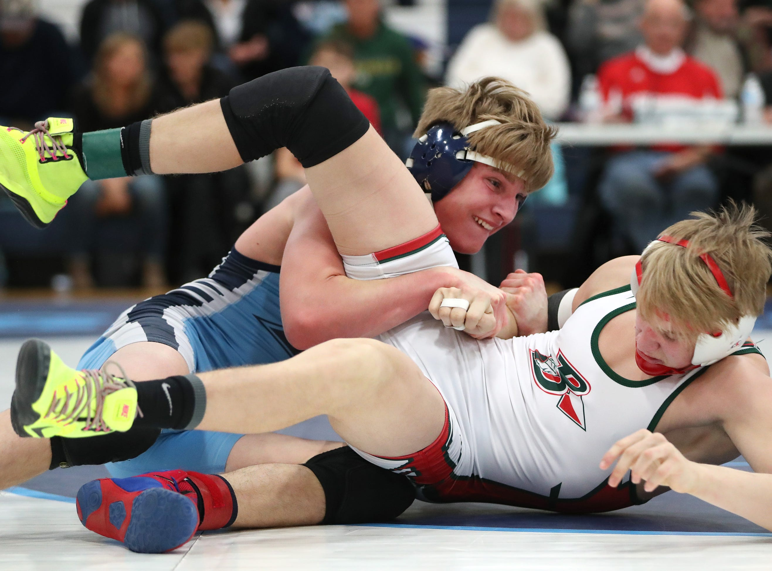 Little Chute's Adam Kilgas tries to control Berlin's Bryce Congdon during their 145-pound first place match in the D2 wrestling regional Saturday Feb. 9, 2019, in Little Chute, Wis. Kilgas won the match 8-3.