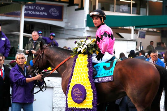 Joel Rosario aboard Game Winner (9) poses for a photo in the winner's circle after winning the Sentient Jet Breeders Cup Juvenile at Churchill Downs.