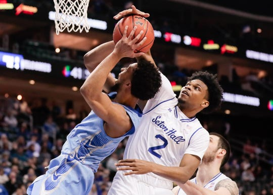 Seton Hall Pirates guard Anthony Nelson (2) blocks a shot by Creighton Bluejays guard Davion Mintz (1)