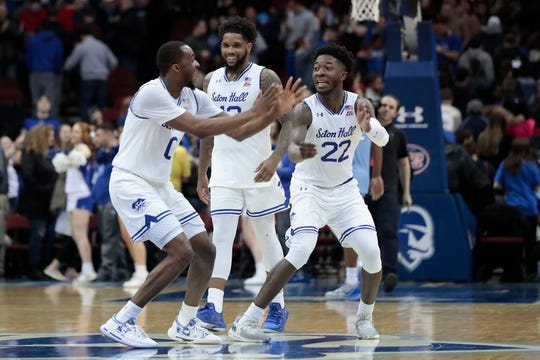 Seton Hall Pirates guard Myles Cale (22) and guard Quincy McKnight (0) celebrate after defeating the Creighton Bluejays.