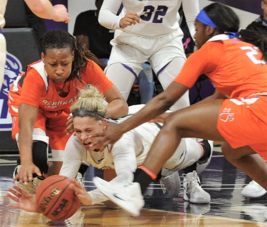 ACU's Lexie Ducat, center, battles Sam Houston State's Jaylonn Walker, right, and another Bearkat for a loose ball in the fourth quarter. Sam Houston State won the game 72-63 on Saturday, Feb. 9, 2019, at Moody Coliseum.