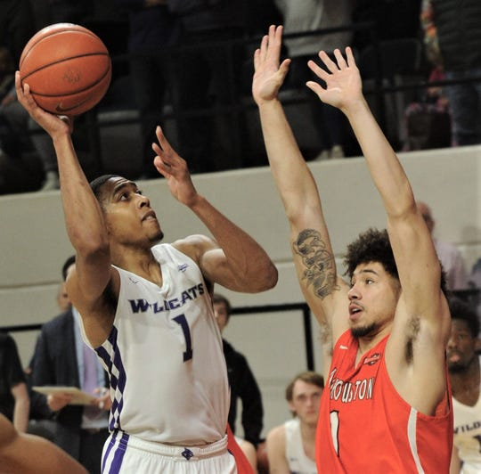 ACU's Jaren Lewis, left, shoots over a Sam Houston State's R.J. Harris. Lewis' basket tied the game at 83 with 1:25 left in the second overtime. The Bearkats beat ACU 90-85 in double overtime Saturday, Jan. 9, 2019, at Moody Coliseum.