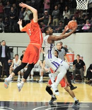 ACU's Jaylen Franklin, right, drives to the basket while Sam Houston State's Albert Almanza defends. Franklin was fouled on the play, but missed both free throws with his team trailing 80-79 with 2:11 left in the second overtime. The Bearkats beat ACU 90-85 in double overtime Saturday, Jan. 9, 2019, at Moody Coliseum.