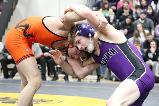 Walton/Delhi's Caleb Robinson and Norwich's Nick Glanville clinch during their 120-pound final Saturday in the Section 4 Division II Tournament at Windsor. Robinson won by pin.