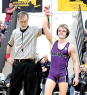 Referee Rick Armstrong raises the arm of Norwich's Dante Geislinger after his 11-2 victory over Windsor's Troy Hayes in the 106-pound final of Saturday's Section 4 Division II Tournament at Windsor.
