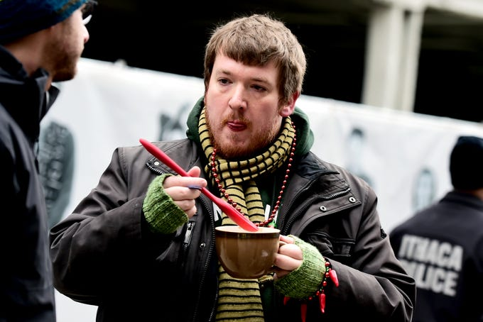 Jake Parker Carver brought a large mug and spoon to taste the offerings of local restaurants during the 21st Annual Downtown Ithaca Chili Cook-off on Saturday, February 8, 2019.