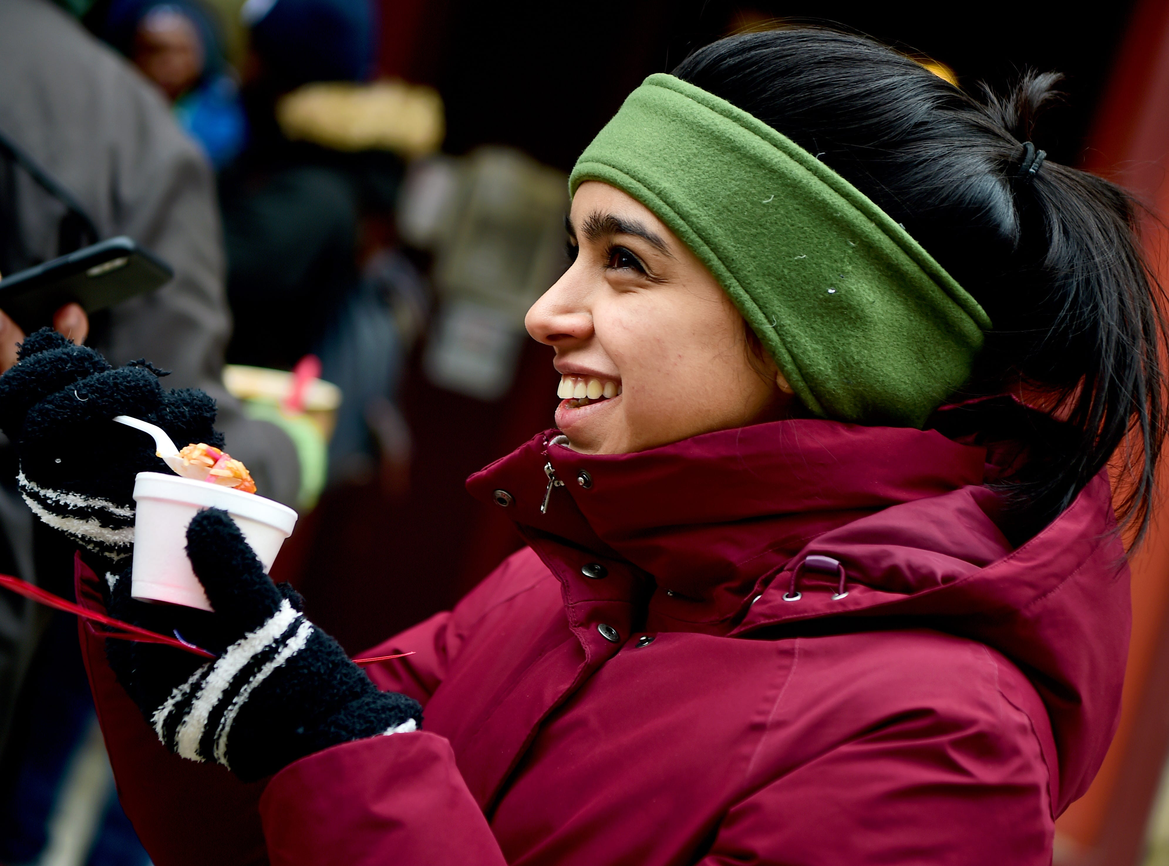 Maryam Quraishi, a Cornell student, tastes chili from Mia's during the 21st Annual Downtown Ithaca Chili Cook-off was held on the Ithaca Commons on Saturday. The event featured unique meat, vegetarian and vegan chilis made by local restaurants. February 8, 2019.