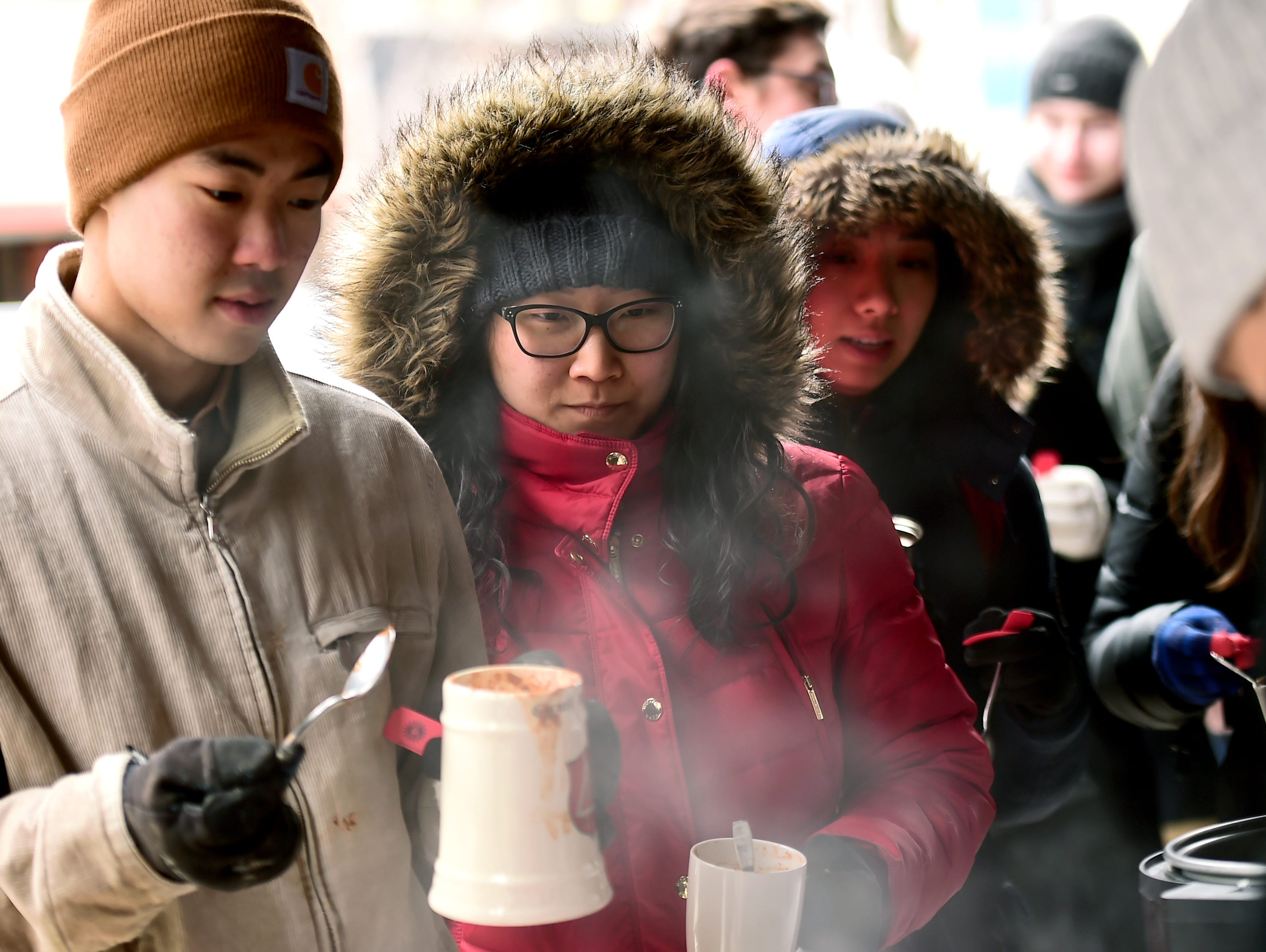 Mia's served up hot chili to the long line of people waiting for a taste during the Downtown Ithaca Chili Cook-off on Saturday, February 8, 2019.