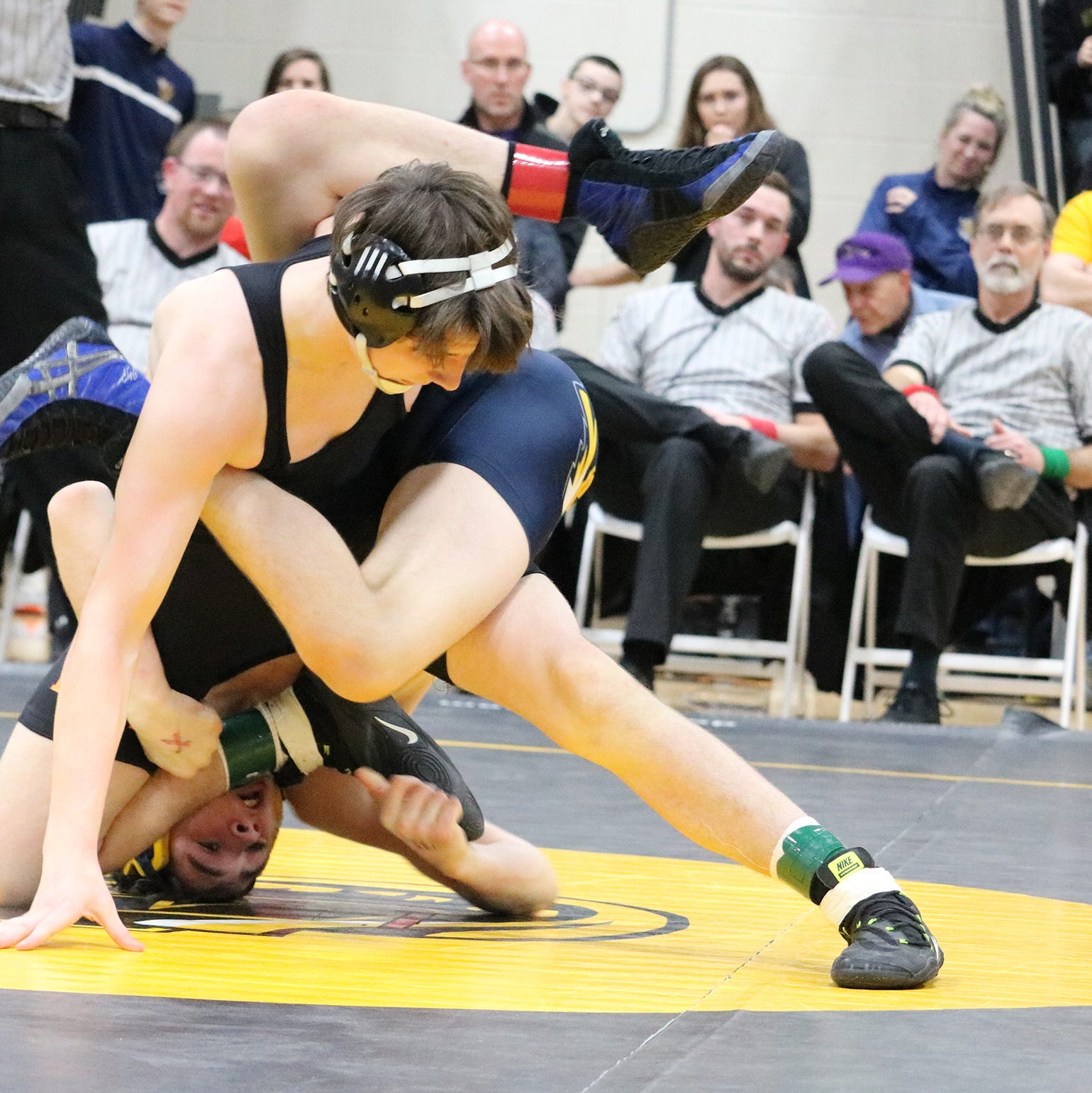 Bainbridge-Guilford/Afton/Harpursville's Brody Oleksak, top, and Tioga's' John Worthing wrestle in the 138-pound final of Saturday's Section 4 Division II Tournament at Windsor. Oleksak won, 3-0 in overtime.