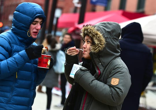 Adam Weld and Nicole Lin, both Cornell students, sample chili made by Cayuga Medical Center during the Annual Downtown Ithaca Chili Cook-off on Saturday, February 8, 2019.