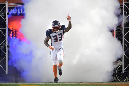 Orlando Apollos safety Will Hill III runs onto the field during player introductions for the team's Alliance of American Football game against the Atlanta Legends on Saturday, Feb. 9, 2019, in Orlando, Fla. (AP Photo/Phelan M. Ebenhack)