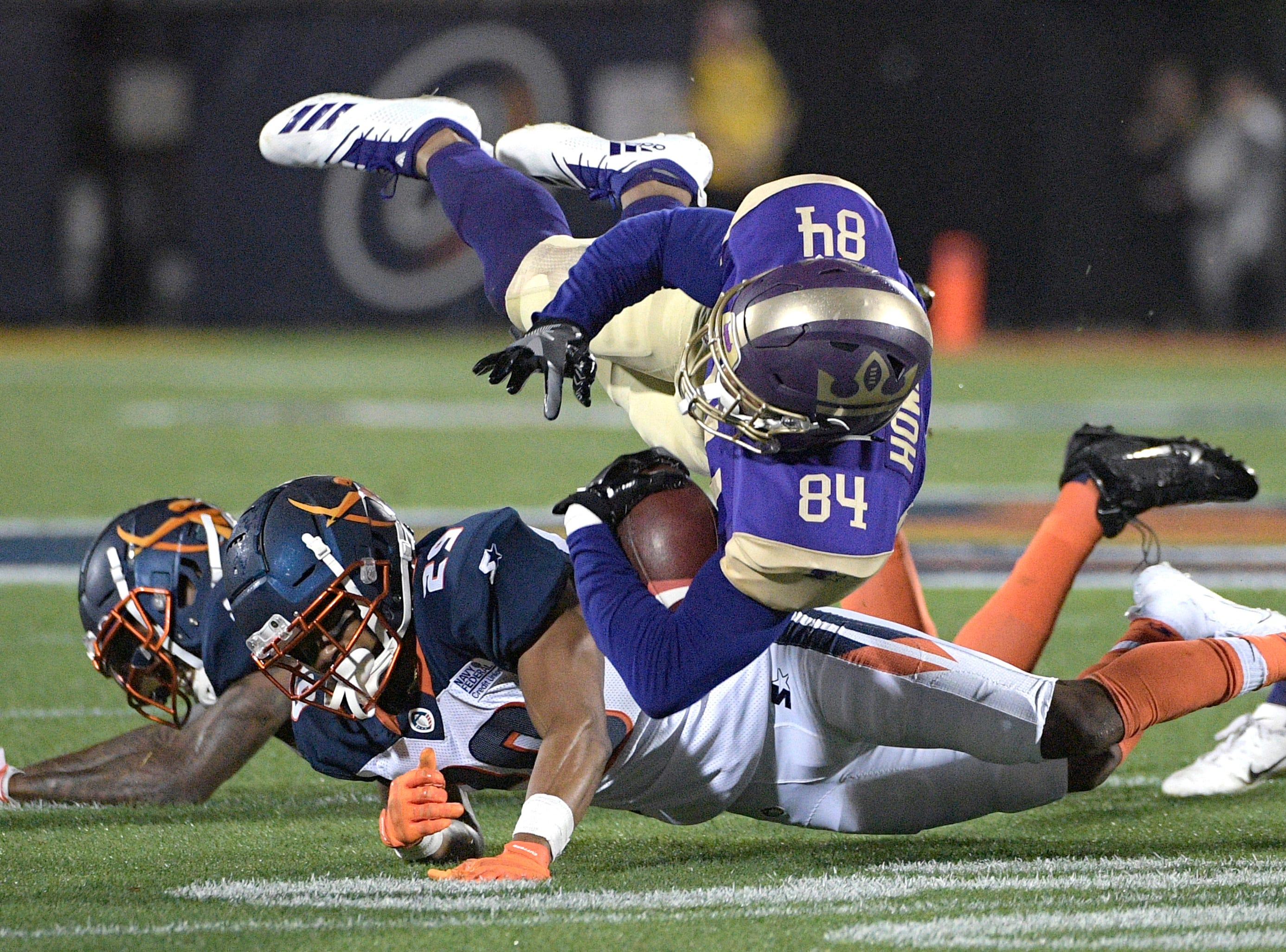 Atlanta Legends receiver Bug Howard (84) is tackled by Orlando Apollos safety Will Hill and defensive back Keith Reaser (29) after catching a pass during the first half of an Alliance of American Football game Saturday, Feb. 9, 2019, in Orlando, Fla. (AP Photo/Phelan M. Ebenhack)