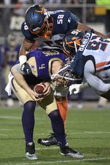 Atlanta Legends quarterback Matt Simms (4) is sacked by Orlando Apollos linebacker Christian French (58) and Josh Banks Sr. (92) during the first half of an Alliance of American Football game Saturday, Feb. 9, 2019, in Orlando, Fla. (AP Photo/Phelan M. Ebenhack)