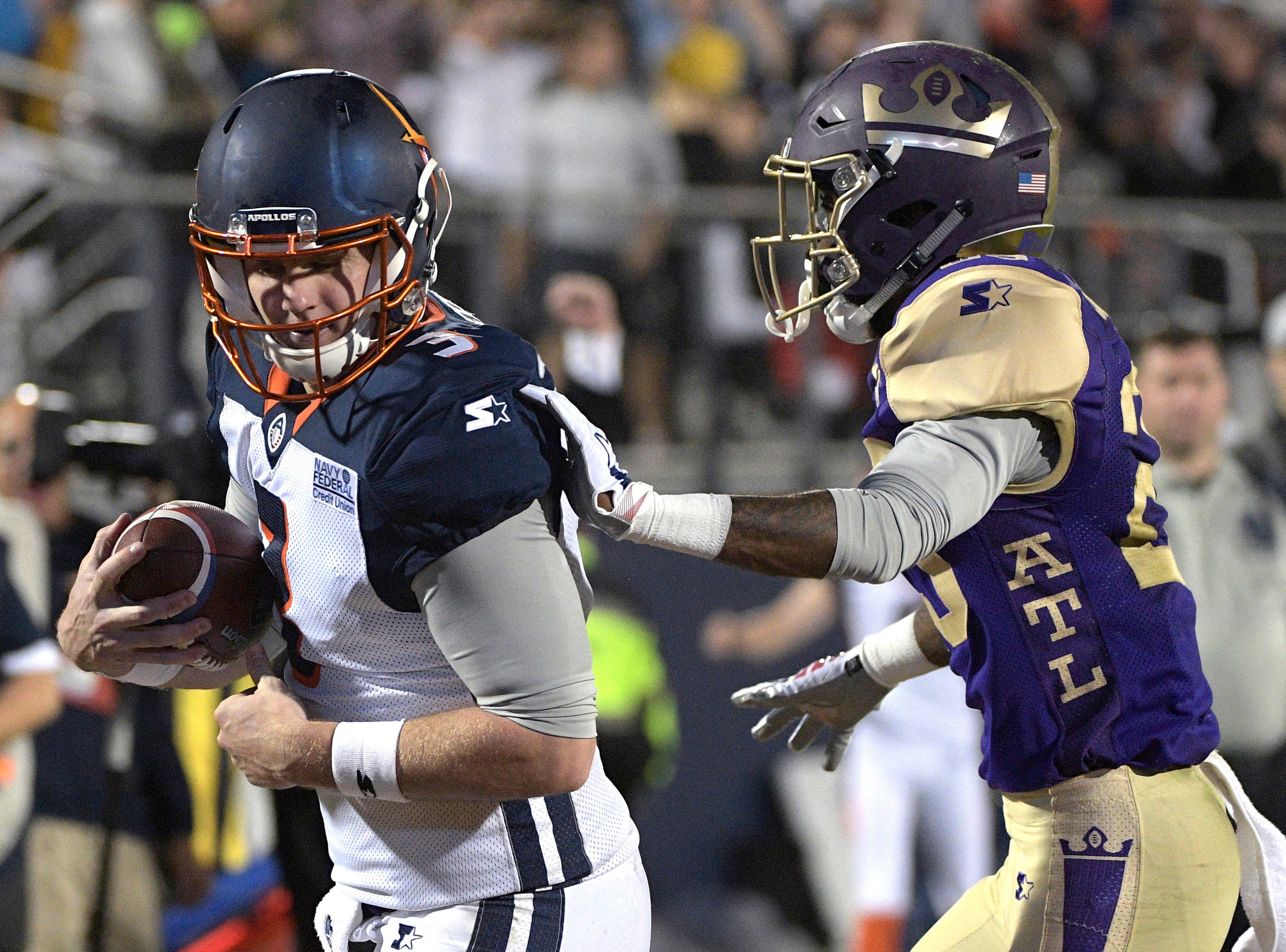 Orlando Apollos quarterback Garrett Gilbert catches a pass from receiver Jalin Marshall for a 5-yard touchdown, in front of Atlanta Legends defensive back Damian Swann during the first half of an Alliance of American Football game Saturday, Feb. 9, 2019, in Orlando, Fla. (AP Photo/Phelan M. Ebenhack)