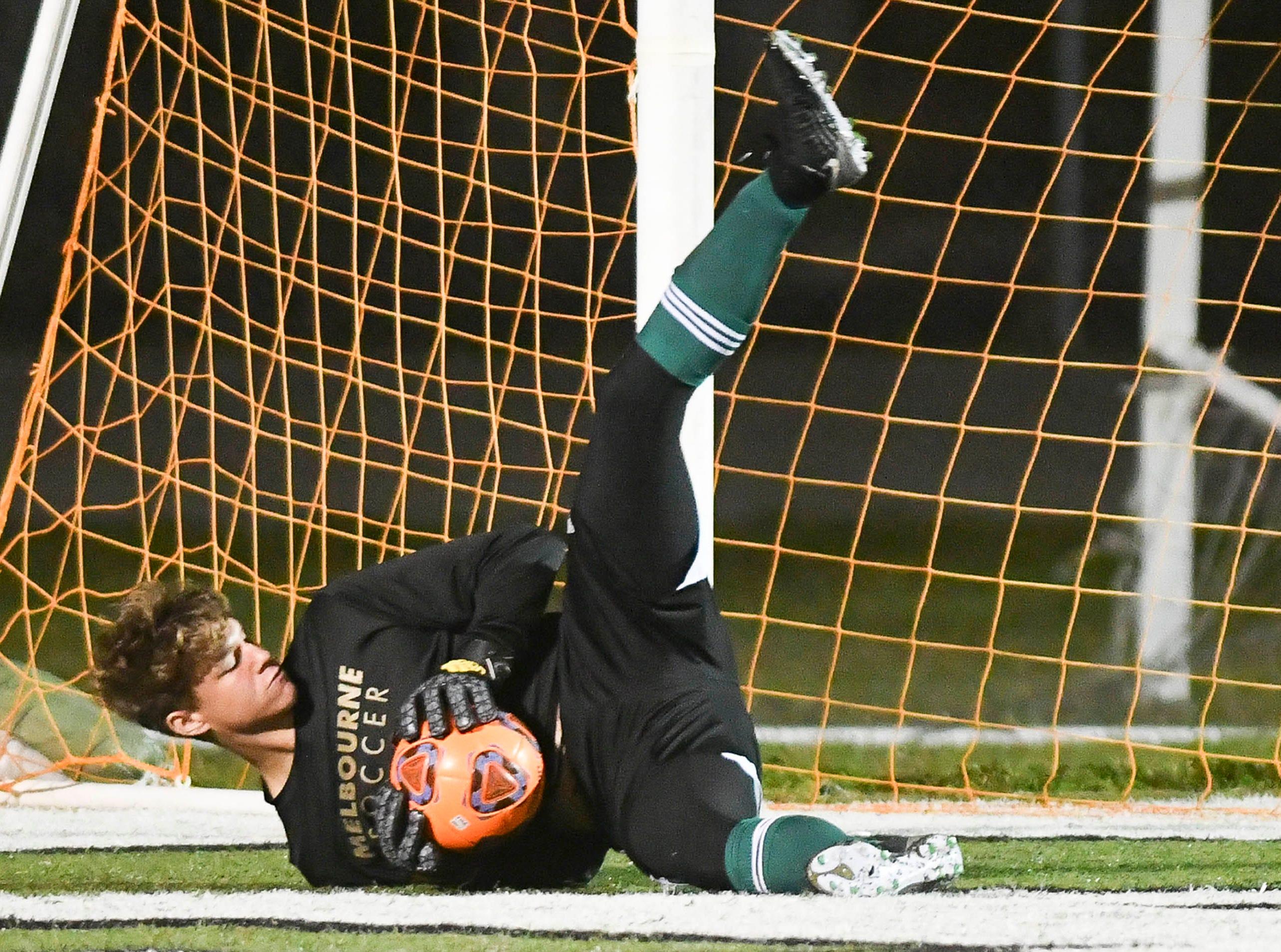 Melbourne goalkeeper Indy Van Buren makes a save during Saturday's Class 4A boys soccer regional semifinal.