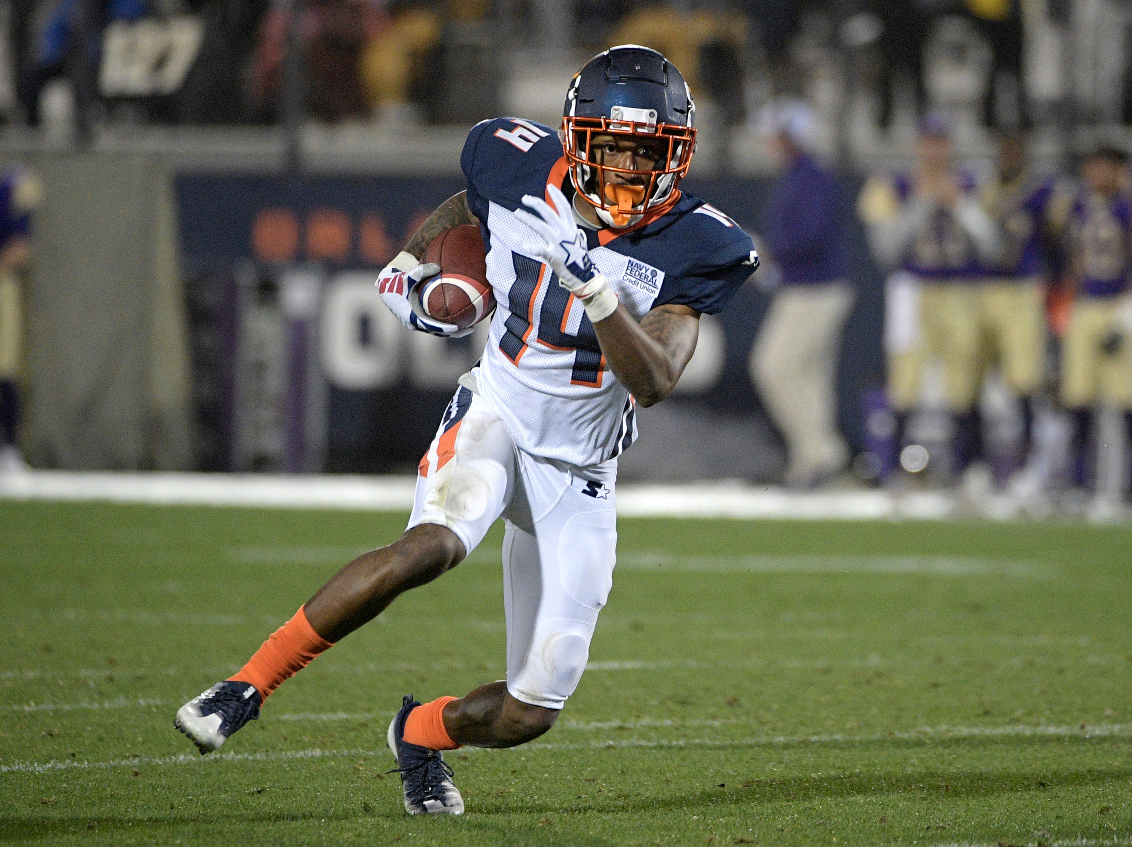 Orlando Apollos receiver Chris Thompson (14) runs after catching a pass during the first half of an Alliance of American Football game against the Atlanta Legends on Saturday, Feb. 9, 2019, in Orlando, Fla. (AP Photo/Phelan M. Ebenhack)