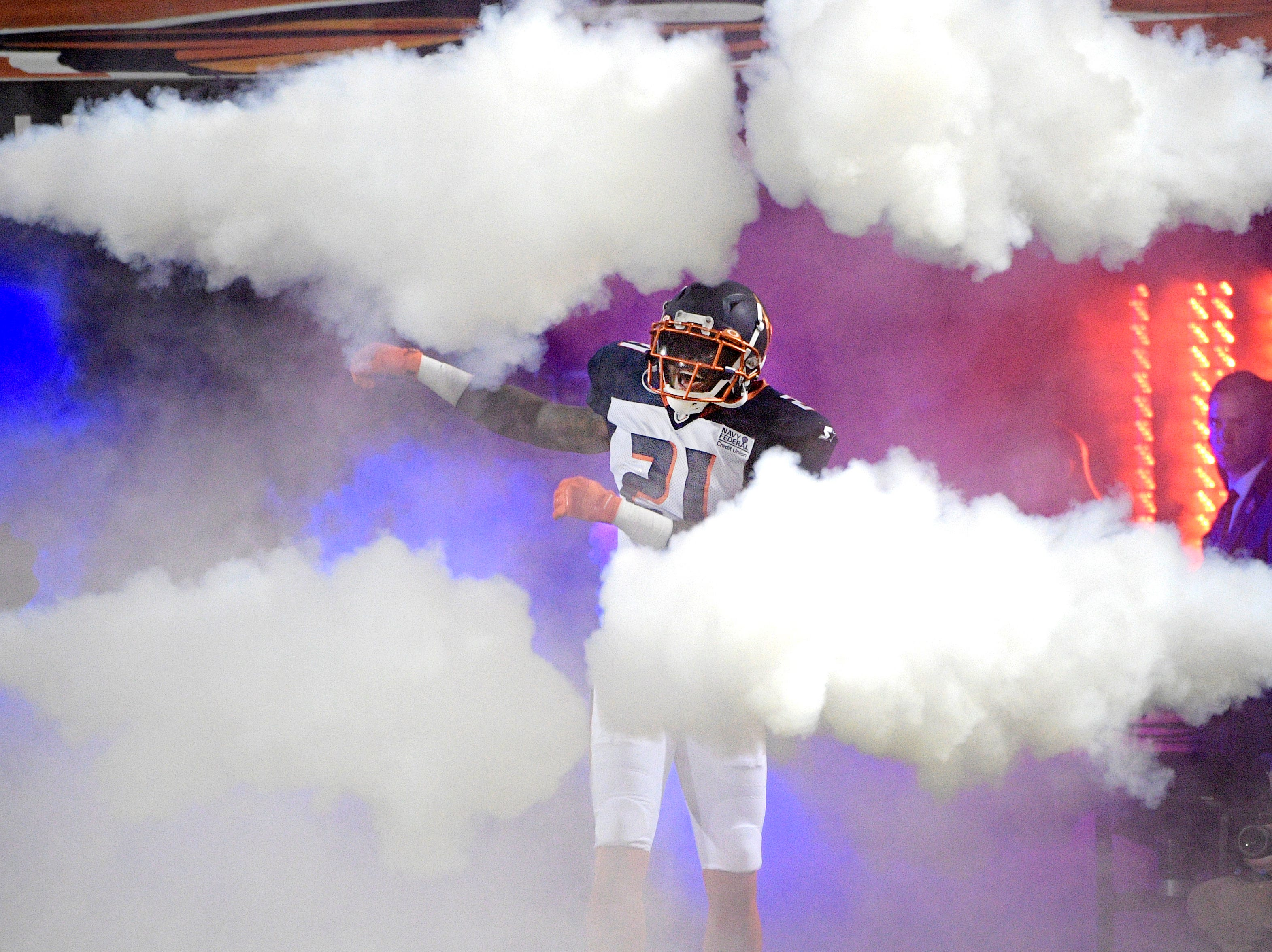 Orlando Apollos safety Jerome Couplin III runs onto the field during player introductions before the team's Alliance of American Football game against the Atlanta Legends on Saturday, Feb. 9, 2019, in Orlando, Fla. (AP Photo/Phelan M. Ebenhack)