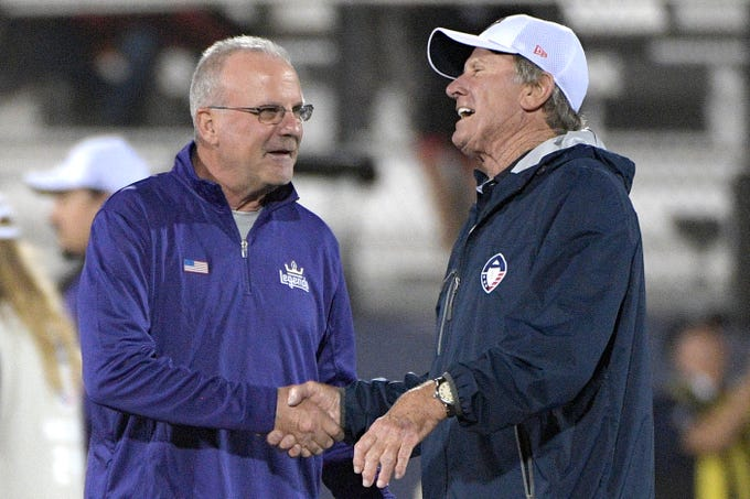 Atlanta Legends coach Kevin Coyle, left, chats with Orlando Apollos coach Steve Spurrier on the field before an AAF football game Saturday, Feb. 9, 2019, in Orlando, Fla. (AP Photo/Phelan M. Ebenhack)