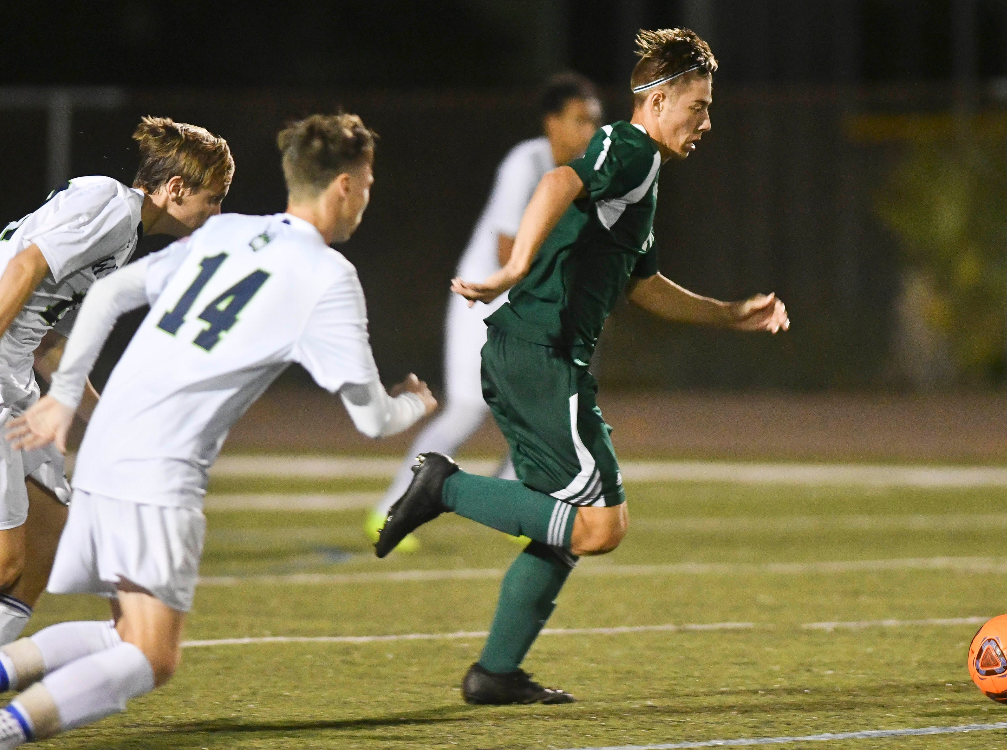 Aden O'Hara of Melbourne drives down towards the Windermere goal during Saturday's Class 4A boys soccer regional semifinal.