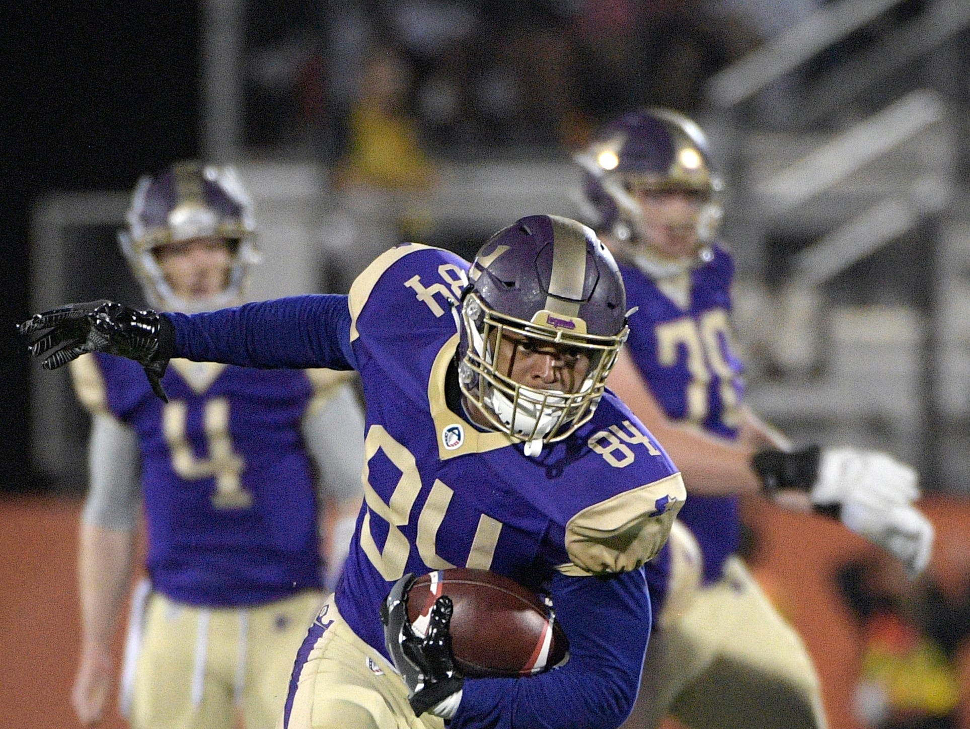 Atlanta Legends receiver Bug Howard (84) runs after catching a pass during the first half of an Alliance of American Football game against the Orlando Apollos on Saturday, Feb. 9, 2019, in Orlando, Fla. (AP Photo/Phelan M. Ebenhack)