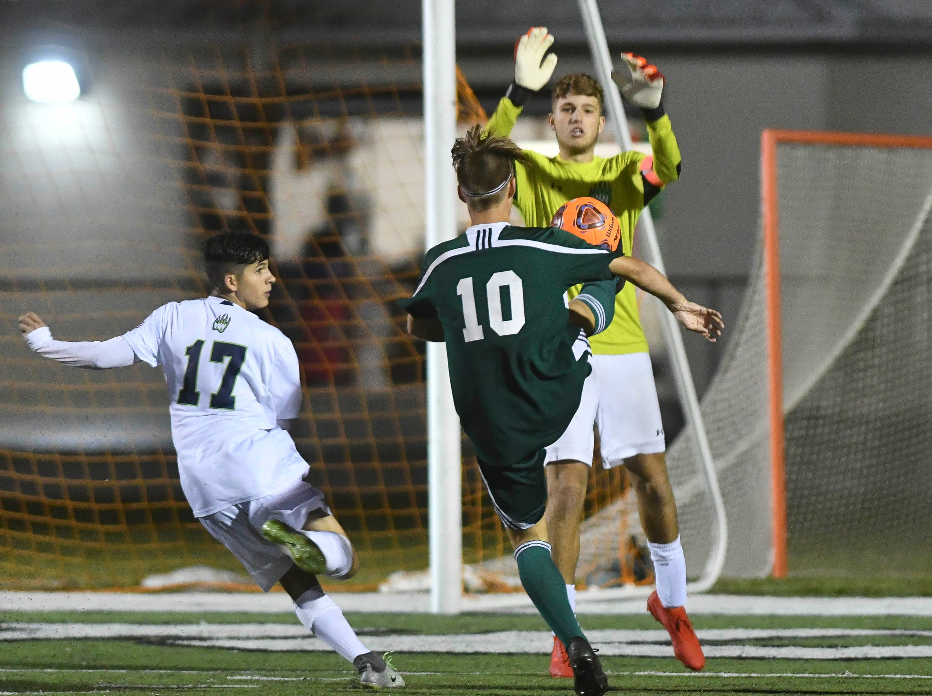 Windermere goalkeeper blocks a shot by Aden O'Hara of Melbourne during Saturday's Class 4A boys soccer regional semifinal.