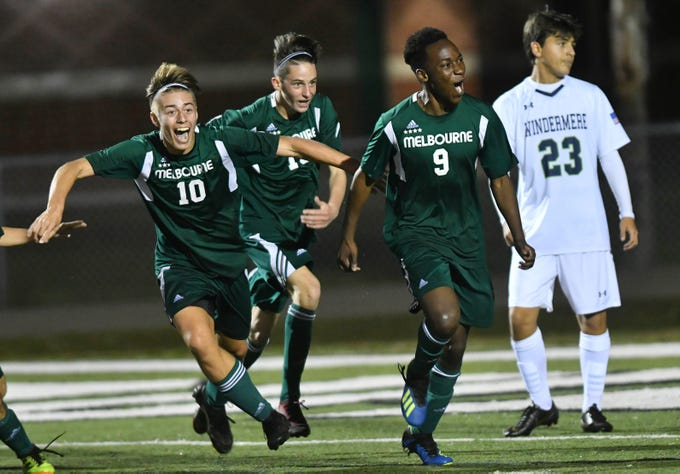 Melbourne players Aden O'Hara, Christian Watts (19) and Osas Osaro (9) celebrate a goal during Saturday's Class 4A boys soccer regional semifinal.