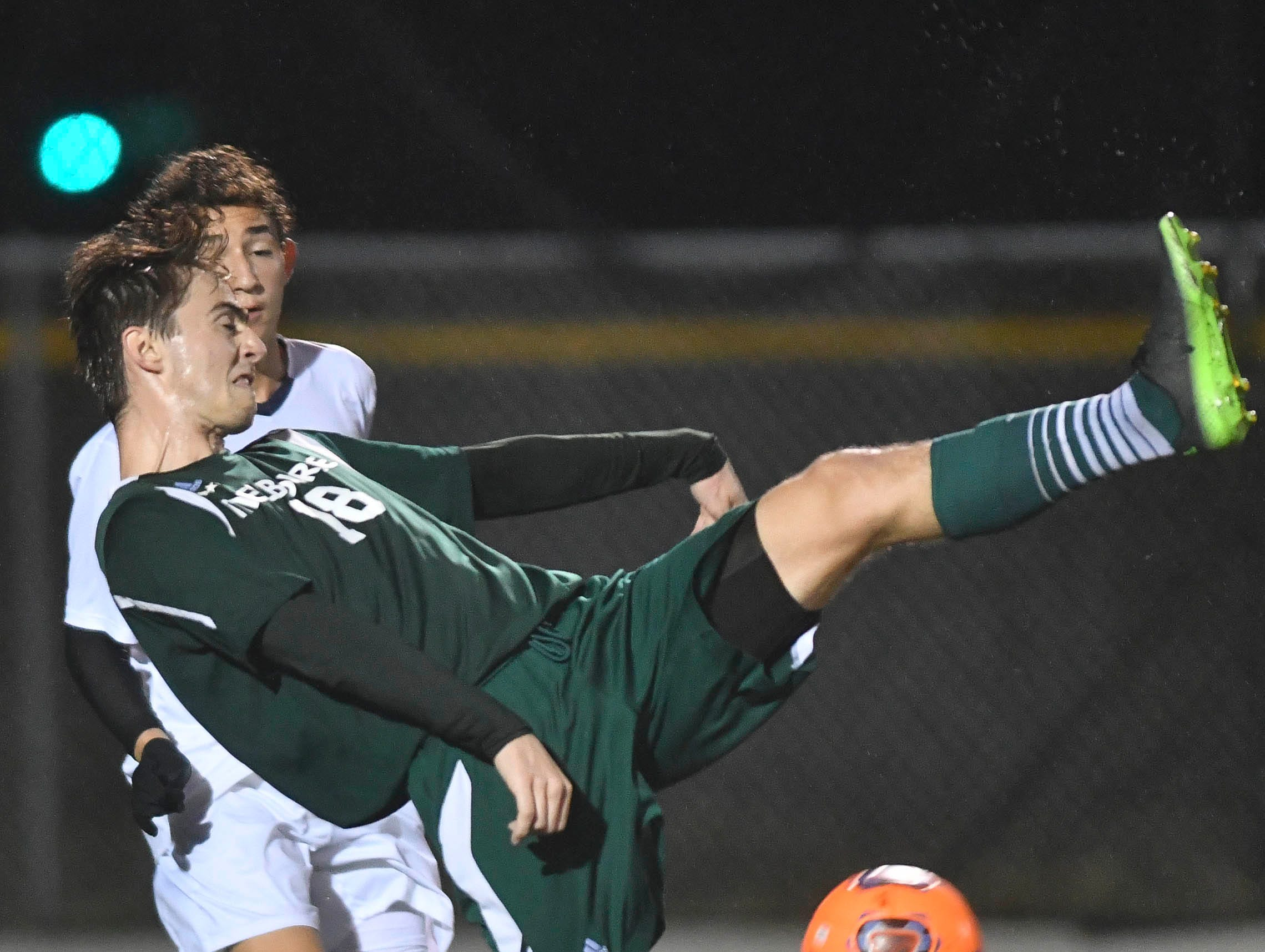 Melbourne's Cooper Bywater tries to bicycle kick the ball during Saturday's Class 4A boys soccer regional semifinal.