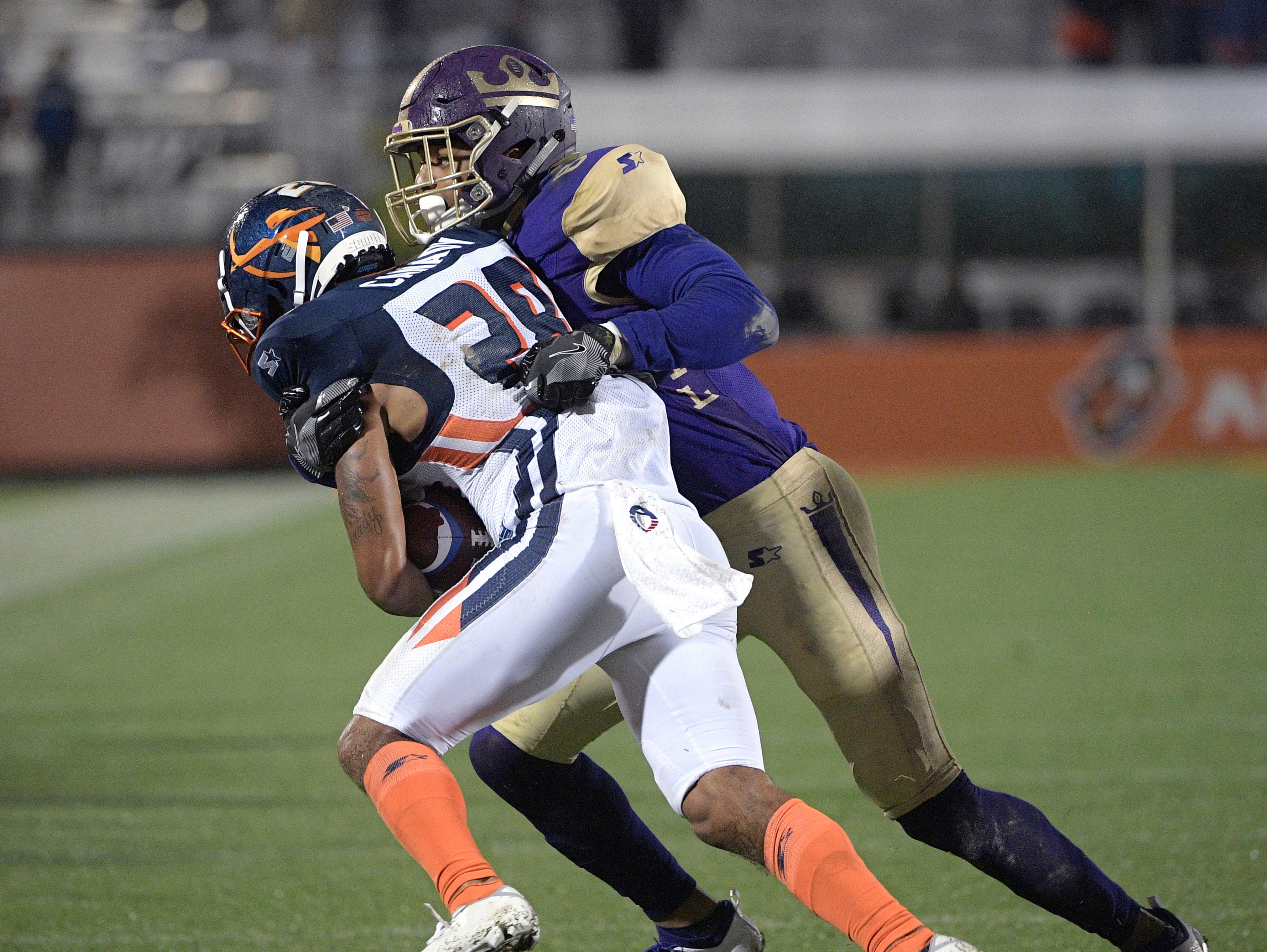 Orlando Apollos defensive back Bryce Canady (28) is tackled by Atlanta Legends receiver Bug Howard (84) after intercepting a pass during the second half of an Alliance of American Football game Saturday, Feb. 9, 2019, in Orlando, Fla. (AP Photo/Phelan M. Ebenhack)