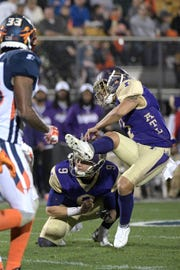Atlanta Legends kicker Younghoe Koo, right, kicks a 27-yard field goal out of the hold of Cameron Nizialek (9) during the first half of an Alliance of American Football game against the Orlando Apollos on Saturday, Feb. 9, 2019, in Orlando, Fla. (AP Photo/Phelan M. Ebenhack)