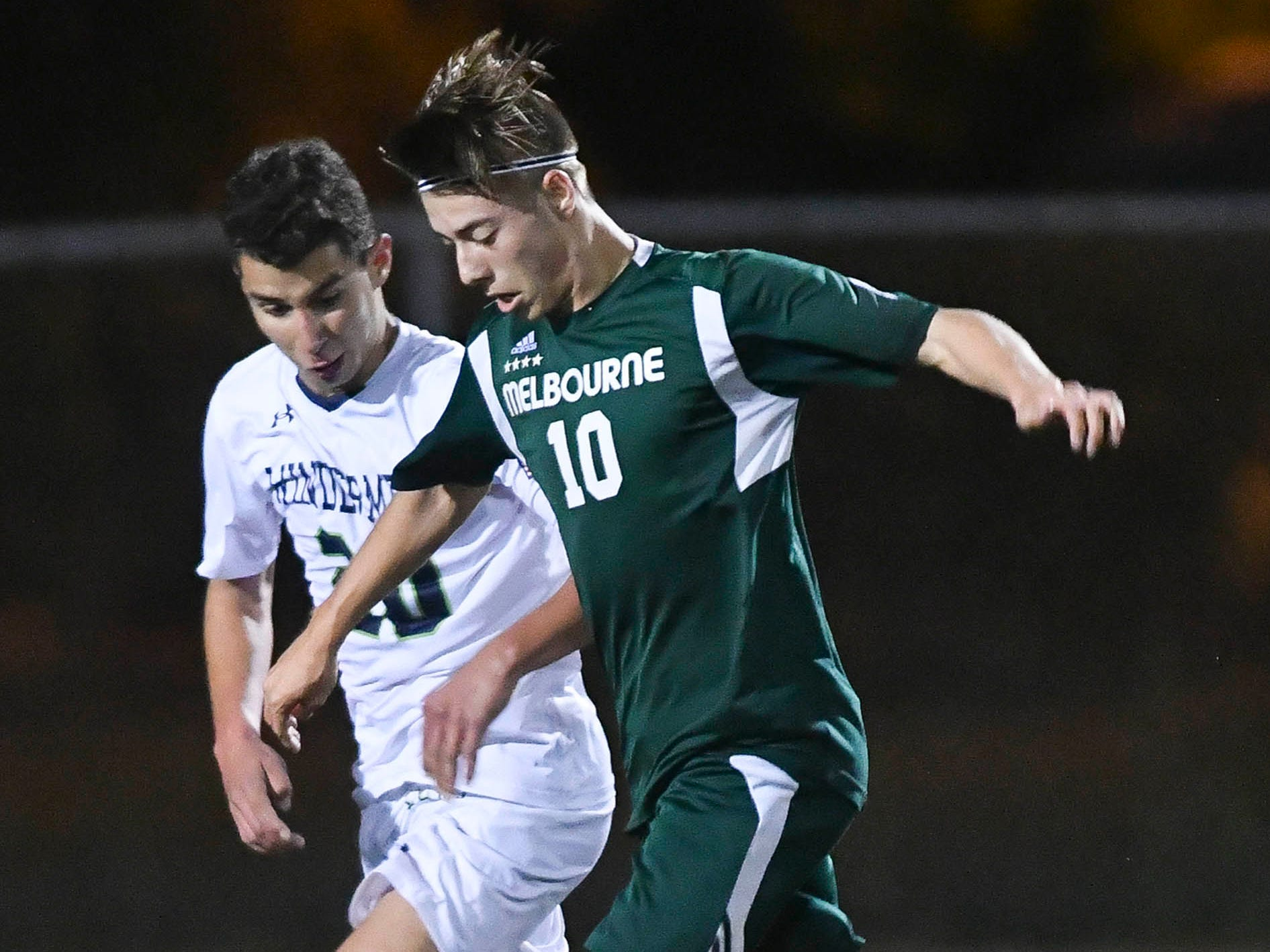 Melbourne's Aden O'Hara tries to drive past a Windermere defender during Saturday's Class 4A boys soccer regional semifinal.