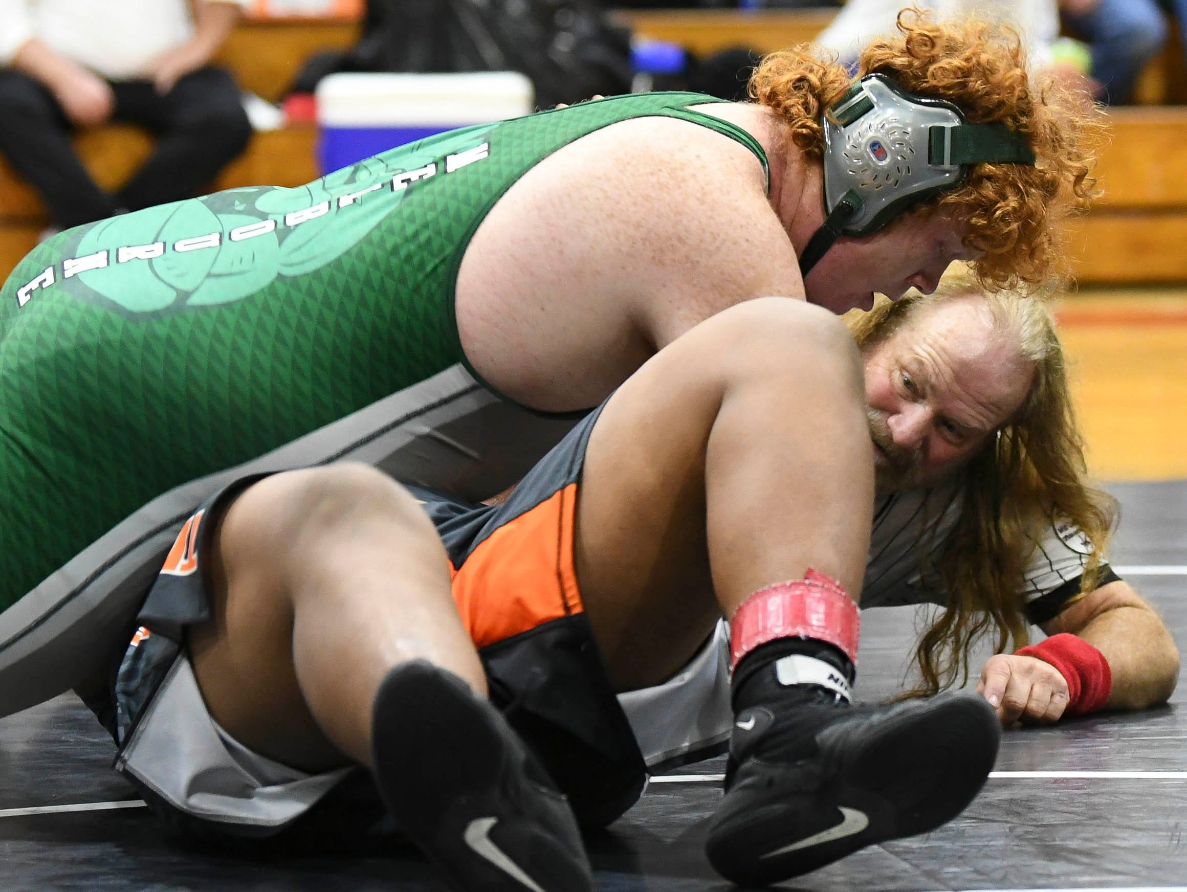 Nathaniel Bryant of Melbourne pins Tay Pratt of Cocoa during Saturday's Cape Coast Conference Wrestling Meet.