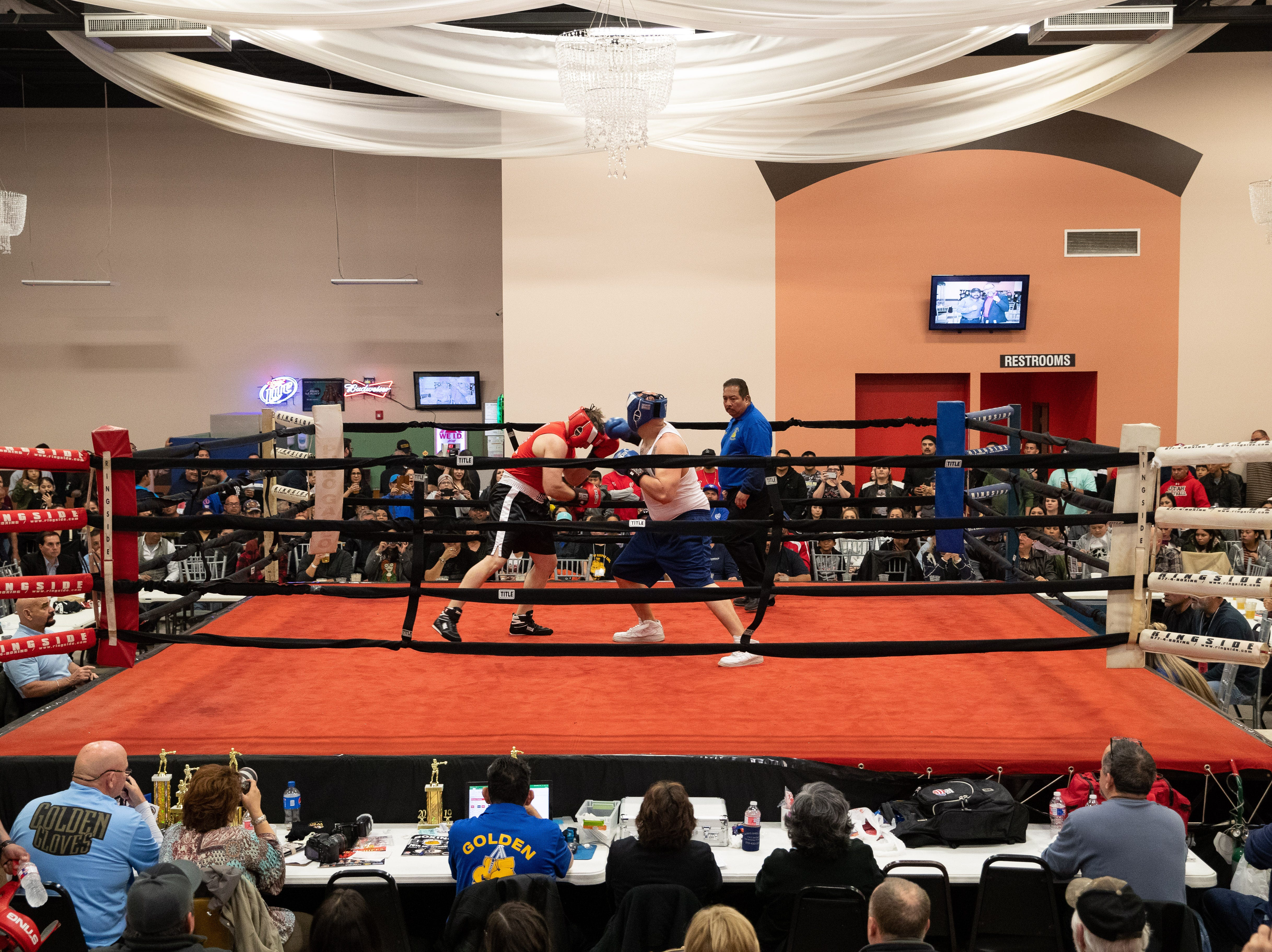 Wisdom Molina fights Arnold Trevino during the regional golden gloves tournament at the Valencia on Saturday, Feb. 9, 2019.