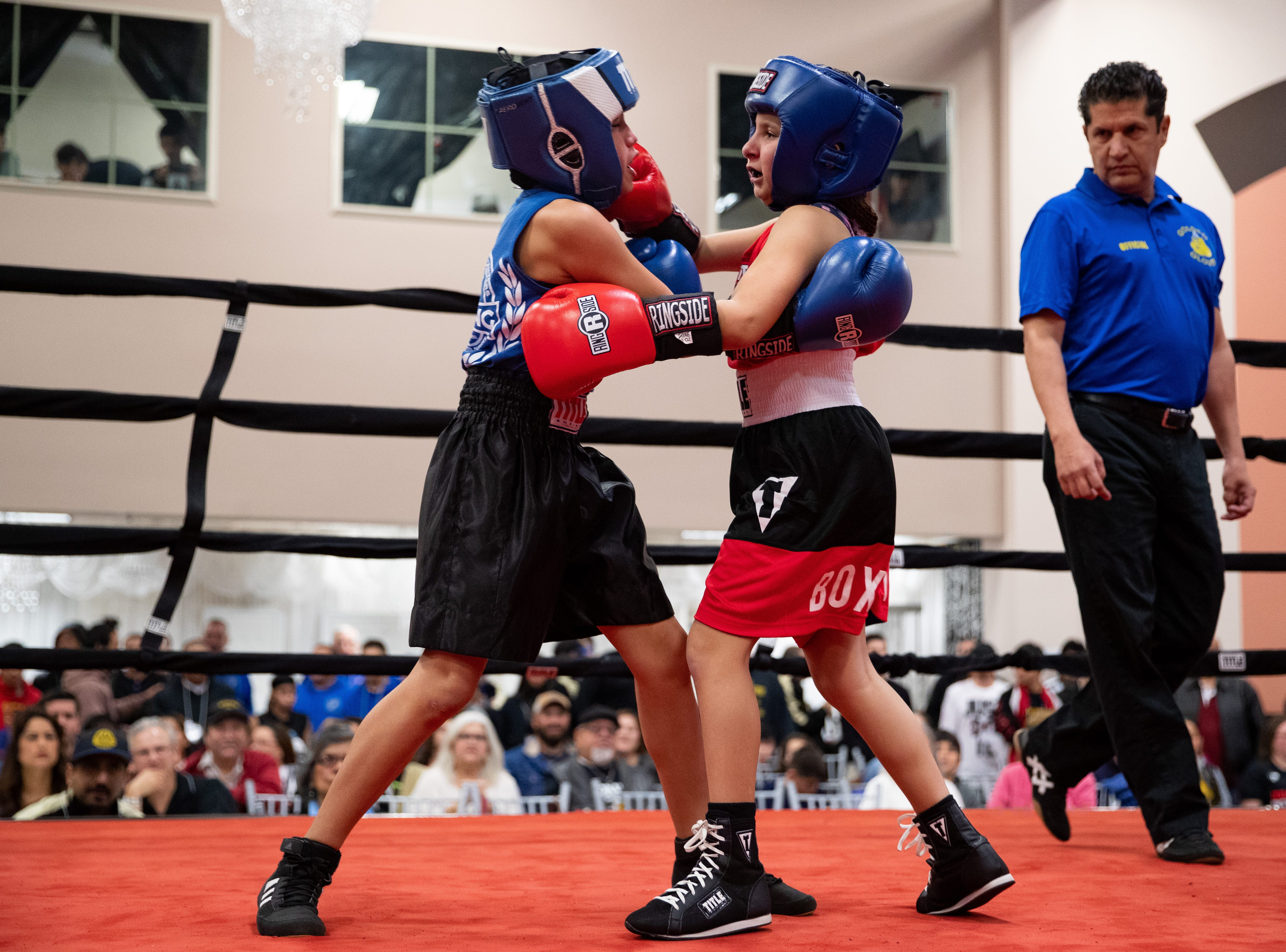 Jinna Adame fights Starr Cruz during the regional golden gloves tournament at the Valencia on Saturday, Feb. 9, 2019.