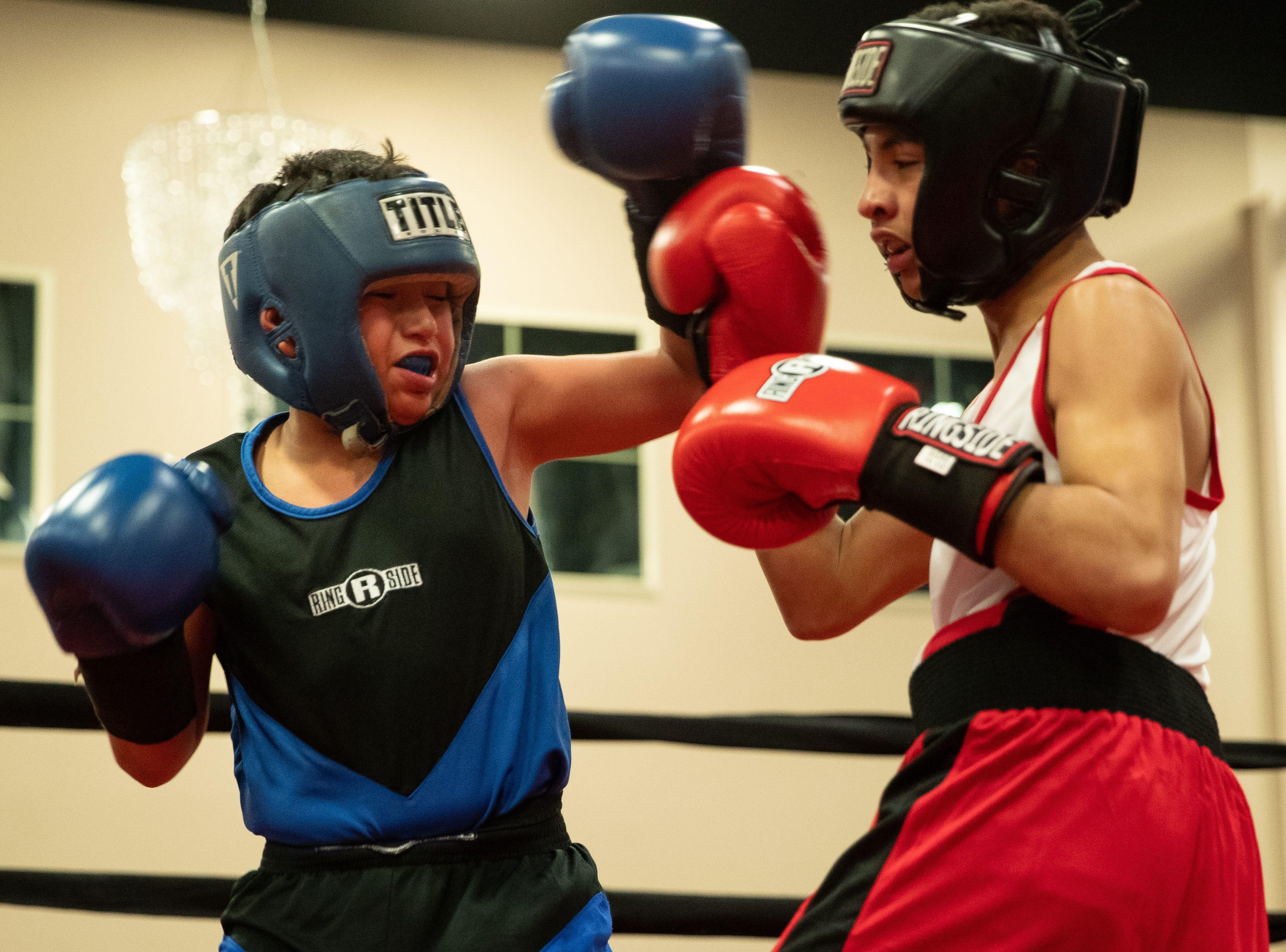Daniel Perez fights Delan Cuevas during the regional golden gloves tournament at the Valencia on Saturday, Feb. 9, 2019.