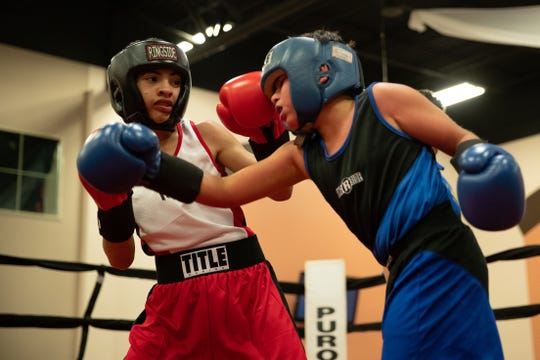 Daniel Perez fights Delan Cuevas during the regional golden gloves tournament at the Valencia on Saturday, Feb. 9, 2019.
