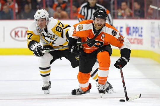 Claude Giroux, right, and Sidney Crosby, left, have had their battles over the years. Both of their teams are fighting for a playoff spot with a little less than two months left in the season.