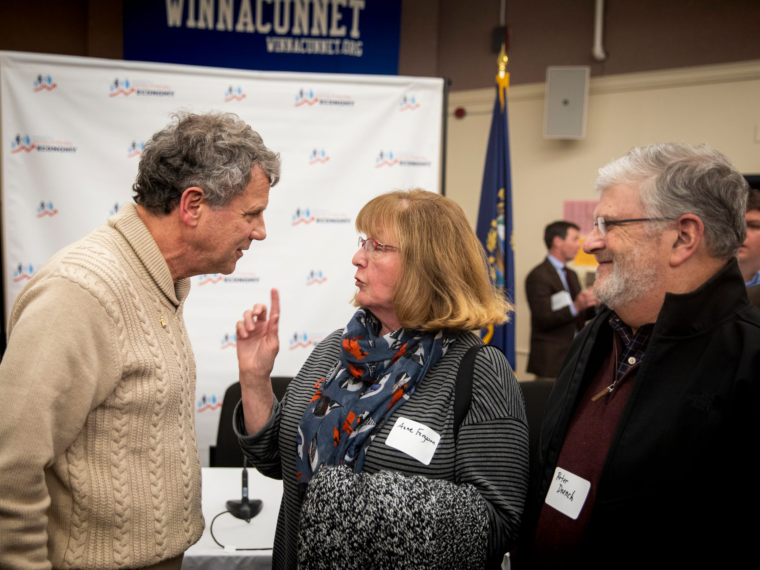 "Senator Sherrod Brown meets Anne Ferguson and Peter Drench after a roundtable with the Campaign for a Family Friendly Economy in a lecture hall at Winnacunnet High School in Hampton, N.H. Friday, February 8, 2019. Ferguson wore her Cleveland pin to the roundtable and talked to Brown about her Ohio roots. The roundtable was part of Brown's ""Dignity of Work"" and his first stop in New Hampshire. Brown traveled to Iowa last week and will visit Nevada and South Carolina in the next few weeks."