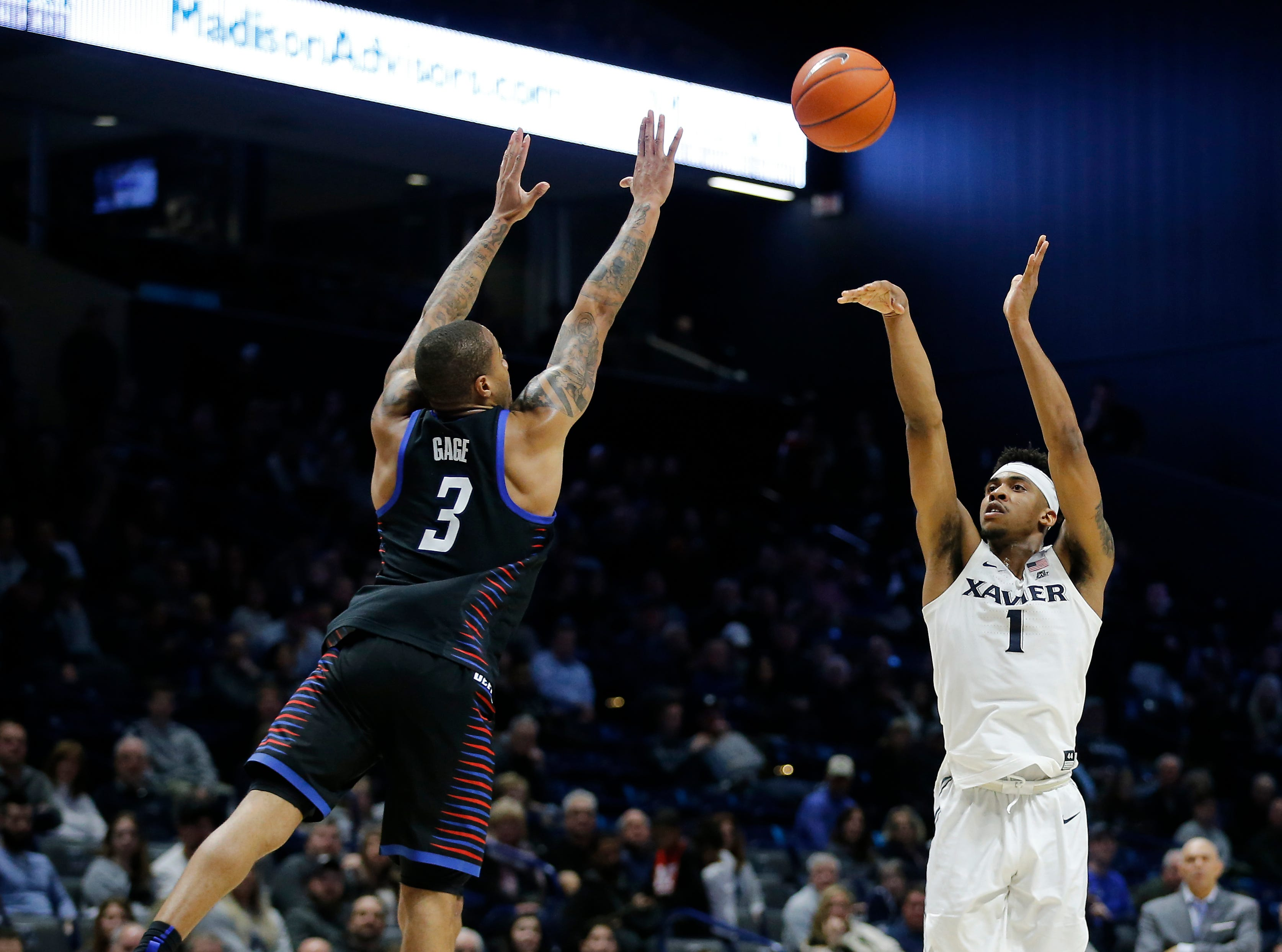 Xavier Musketeers guard Paul Scruggs (1) shoots over DePaul Blue Demons guard Devin Gage (3) in the second half of the NCAA Big East Conference game between the Xavier Musketeers and the DePaul Blue Demons at the Cintas Center in Cincinnati on Saturday, Feb. 9, 2019. Xavier lost its sixth game in a row, 74-62.