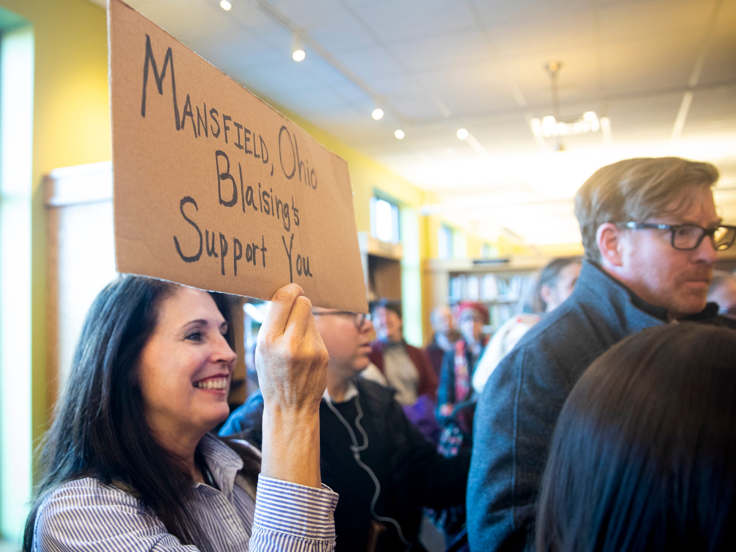 Timberly Blaising holds a homemade sign for Senator Sherrod Brown during a meet and greet at Gibson's Bookstore in Concord, N.H. Saturday, February 9, 2019. Blaising drove from Massachusetts to see Brown, a family friend from Mansfield, OH. Her sister went to high school with Brown and their mothers were friends.