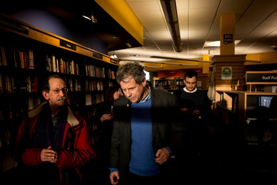 Senator Sherrod Brown talks with Arnie Alpert after a meet and greet at Gibson's Bookstore in Concord, N. H. Saturday, February 9, 2019.