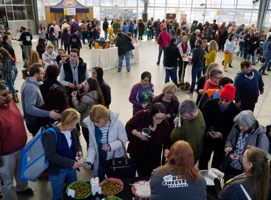 Cheese geeks crowd into the greenhouse at Jungle Jims to attend the Big Cheese Festival,  Saturday, Feb. 9, 2019.