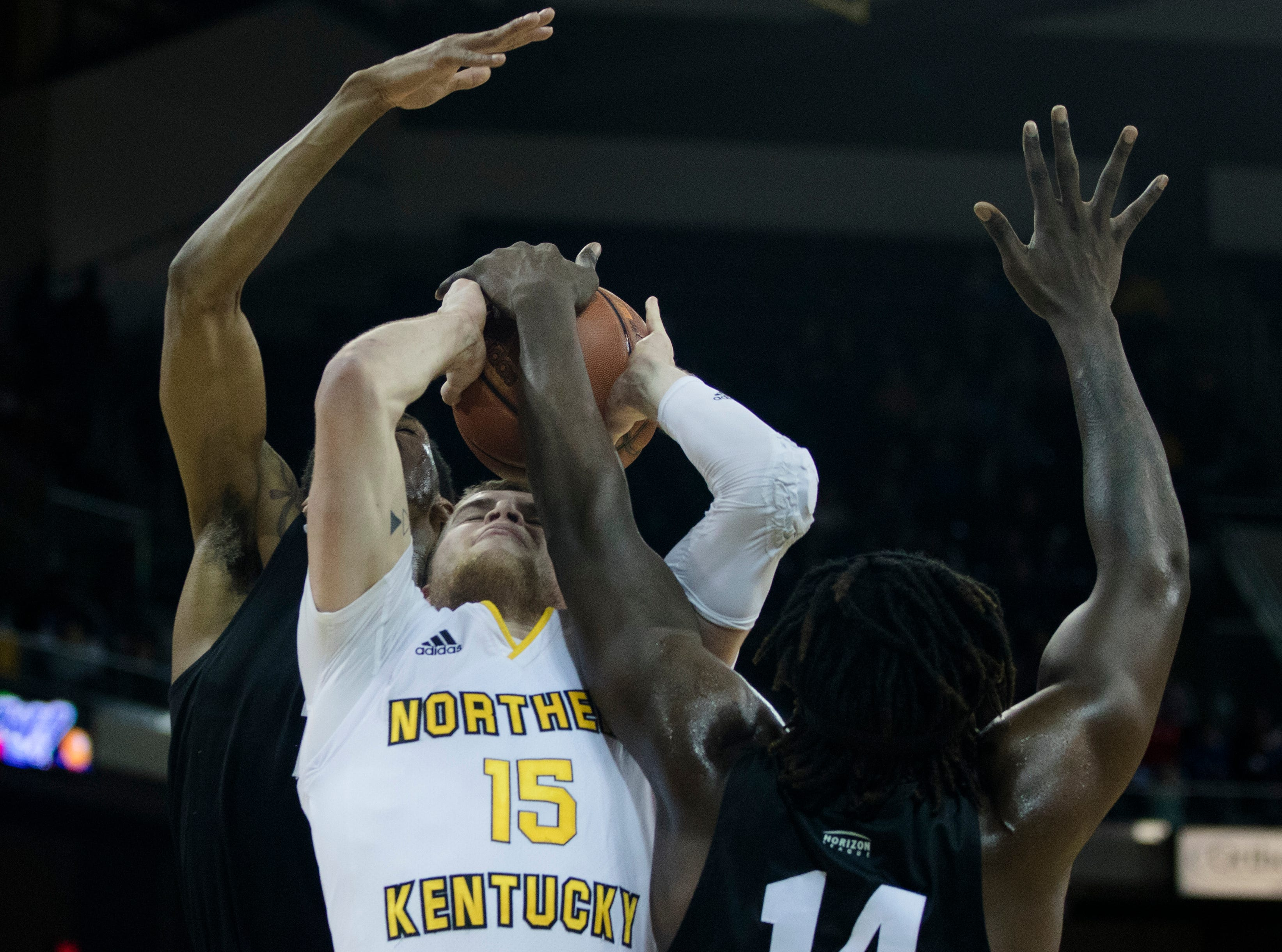Northern Kentucky Norse guard Tyler Sharpe (15) draws a blocking foul from Oakland Golden Grizzlies forward Xavier Hill-Mais (14) in the first half of the men's NCAA basketball game between Northern Kentucky Norse and Oakland Golden Grizzlies on Saturday, Feb. 9, 2019, at BB&T Arena in Highland Heights, Ky.