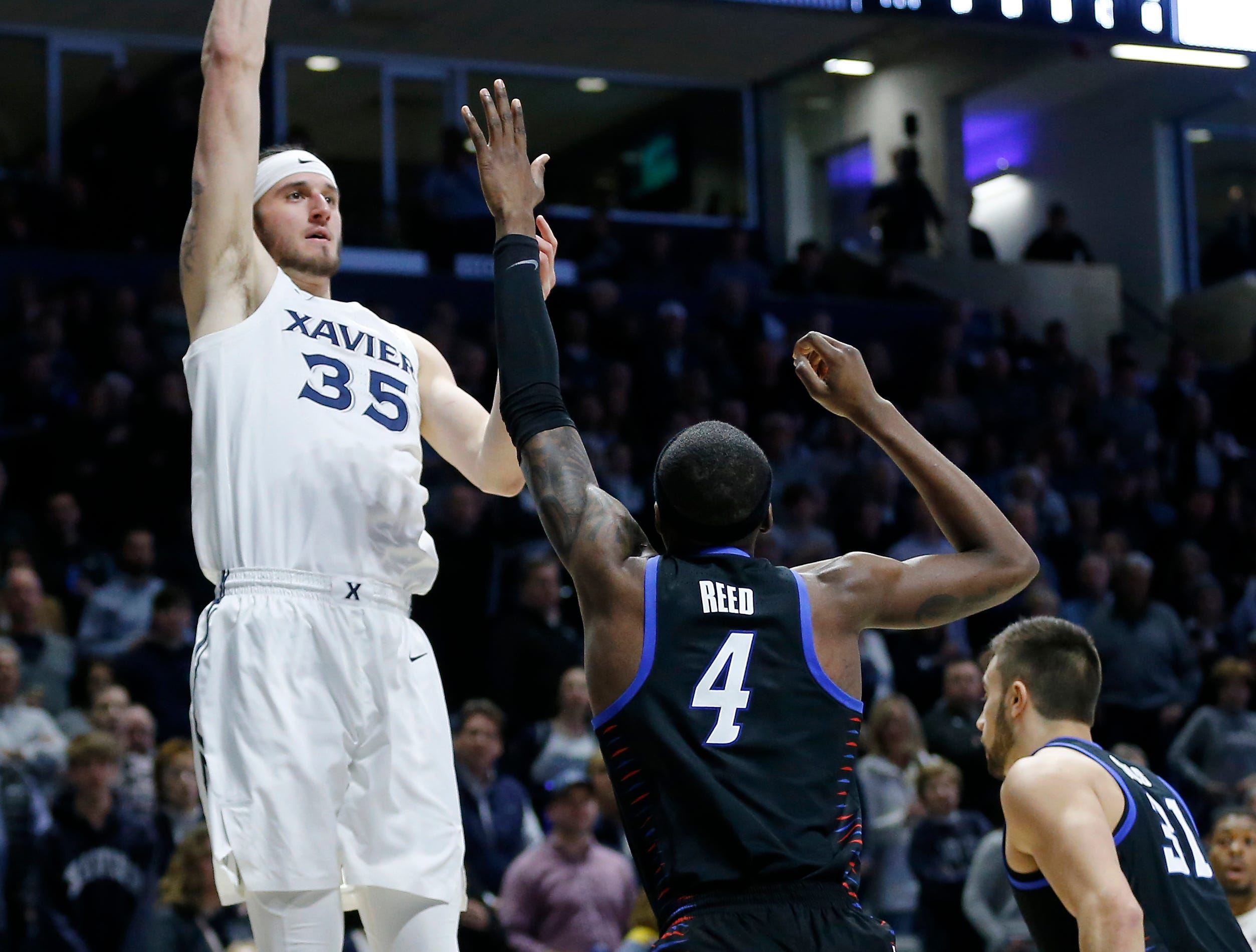 Xavier Musketeers forward Zach Hankins (35) puts up a shot in the first half of the NCAA Big East Conference game between the Xavier Musketeers and the DePaul Blue Demons at the Cintas Center in Cincinnati on Saturday, Feb. 9, 2019.