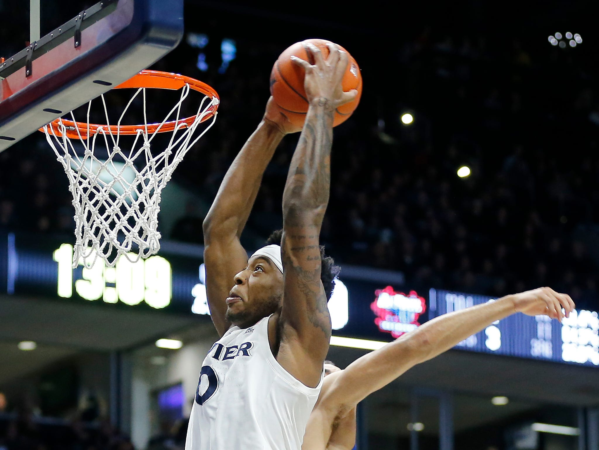 Xavier Musketeers forward Tyrique Jones (0) dunks over DePaul Blue Demons guard Lyrik Shreiner (0) in the second half of the NCAA Big East Conference game between the Xavier Musketeers and the DePaul Blue Demons at the Cintas Center in Cincinnati on Saturday, Feb. 9, 2019. Xavier lost its sixth game in a row, 74-62.
