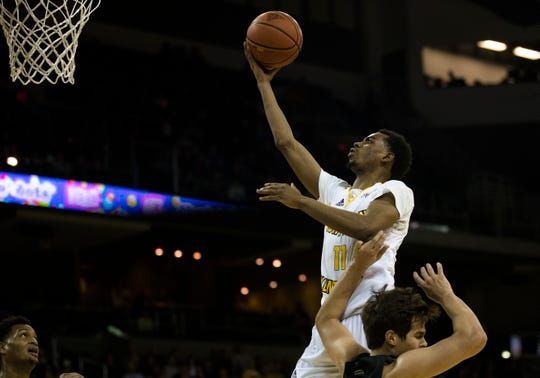 Northern Kentucky Norse guard Jalen Tate (11) shoots a layup as Oakland Golden Grizzlies guard Braden Norris (1) makes contact in the second half of the men's NCAA basketball game between Northern Kentucky Norse and Oakland Golden Grizzlies on Saturday, Feb. 9, 2019, at BB&T Arena in Highland Heights, Ky. Northern Kentucky Norse defeated Oakland Golden Grizzlies 79-64.
