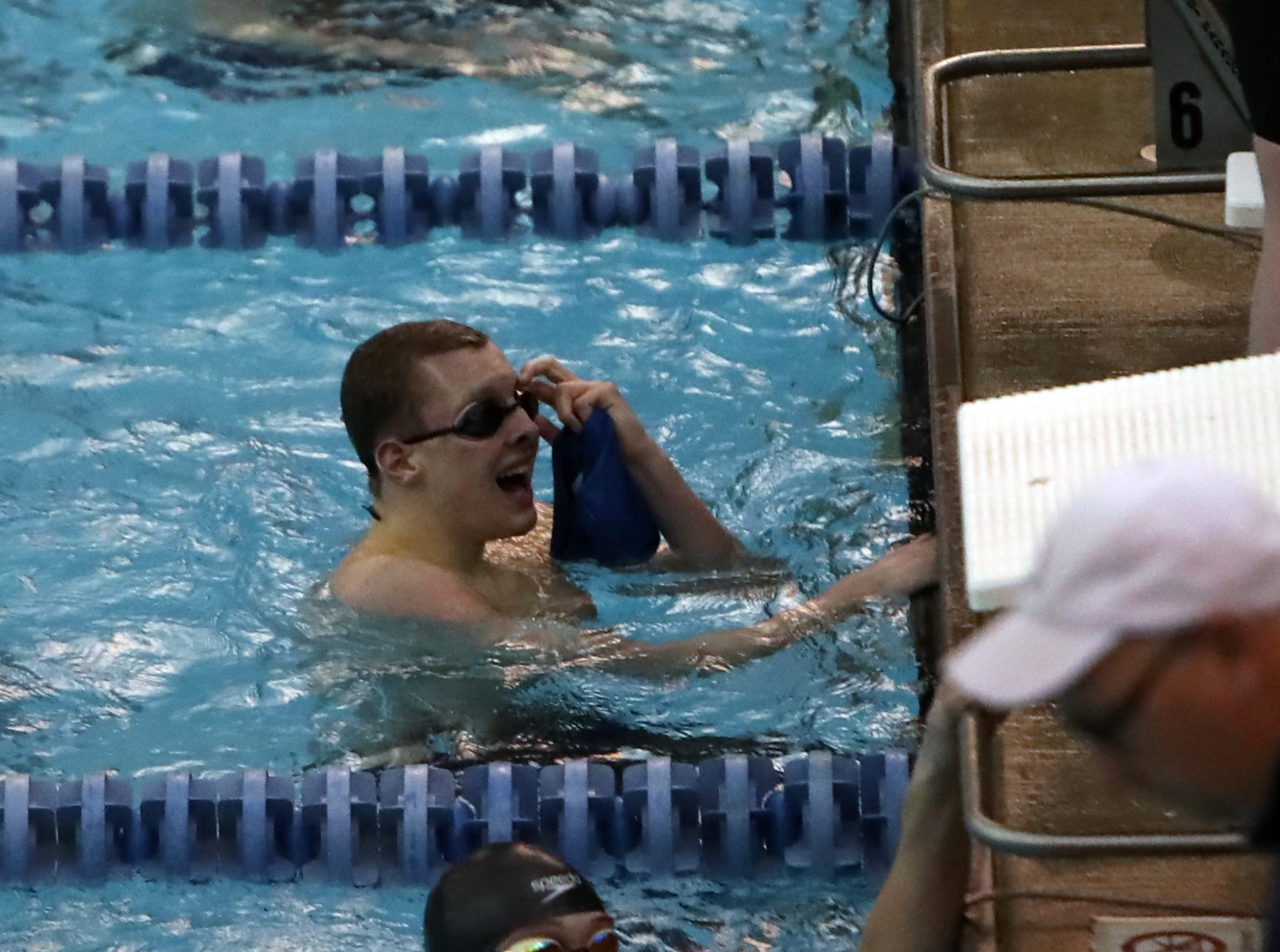 Highlands' Brendan Conley looks up at the scoreboard to see he has won the Boys 200 yard Freestyle at the Regional Final at the KHSAA Regional Swimming Finals in Erlanger, Kentucky.